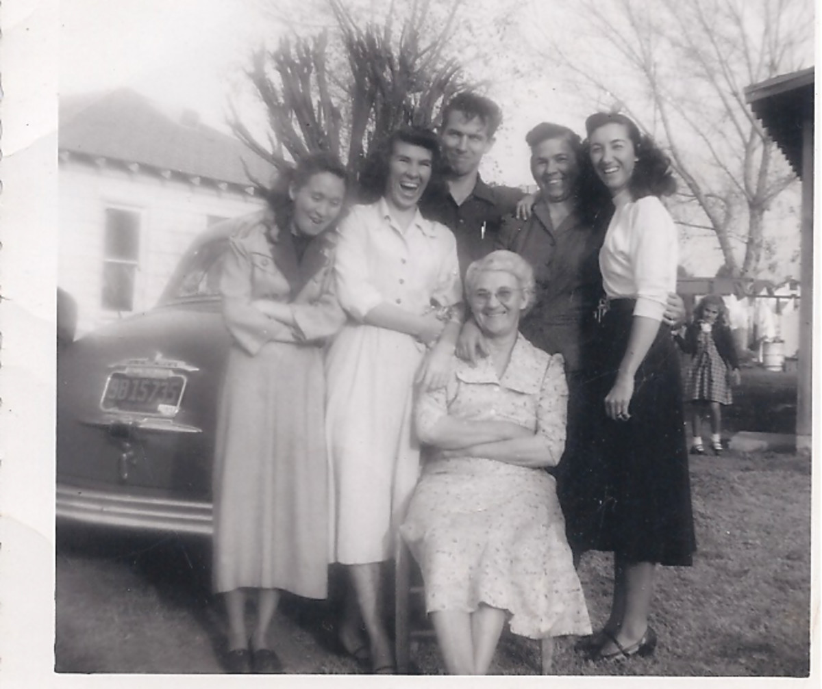 My Mother's mother and family in the 50's. My mother is on the left of my grandmother. My grandmother is sitting in front.... Phyllis (the one burned badly) is located to far left, looking down.