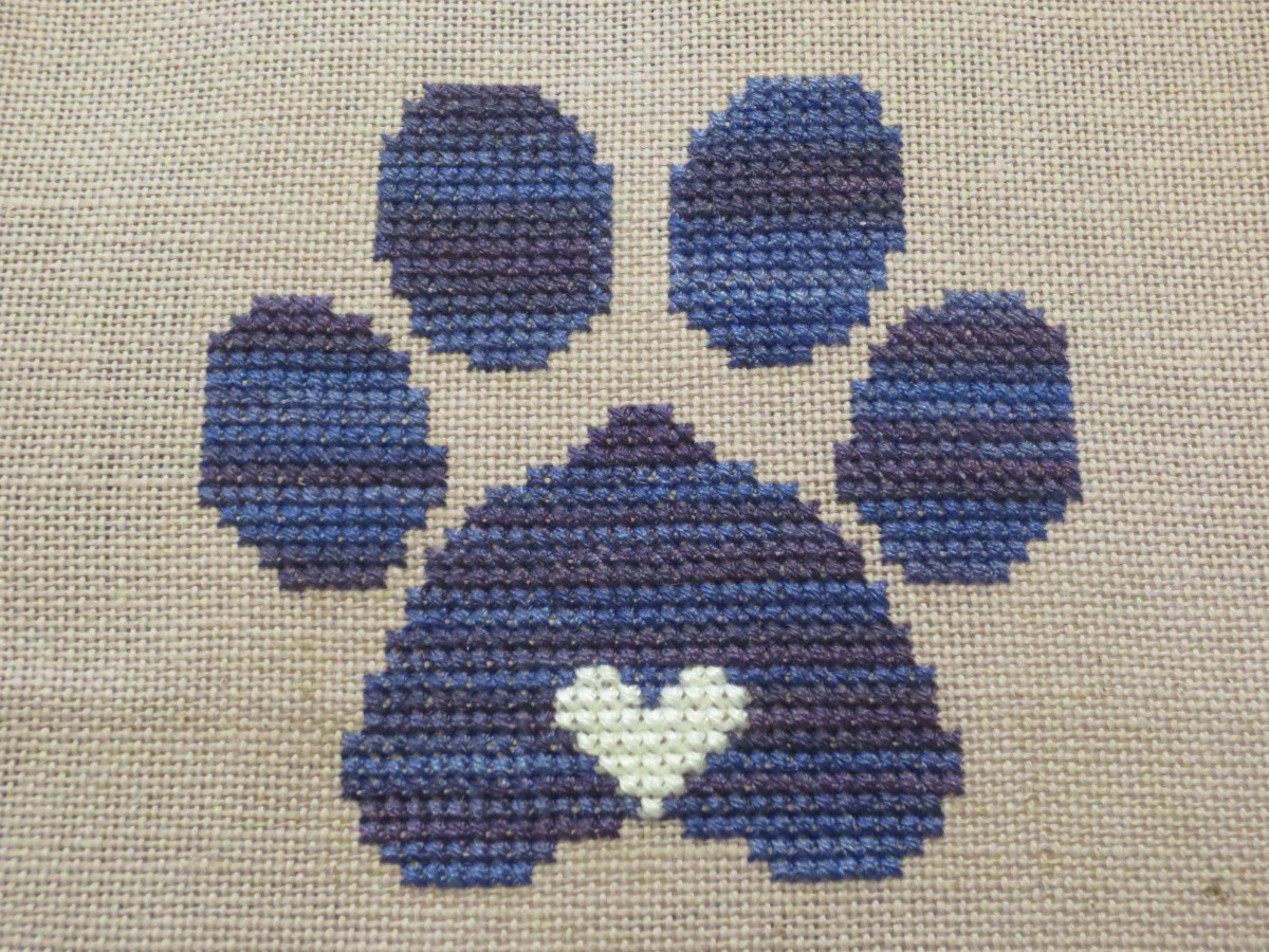 my own stitching of a pattern I designed in memory of our dog Penny after she passed away