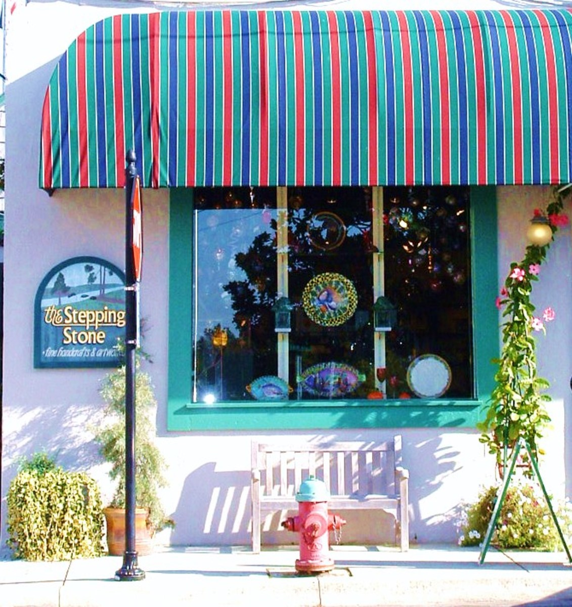 The Stepping Stone sells unique American-made fine handcrafts: pottery, glass, metal, wood & jewelry.