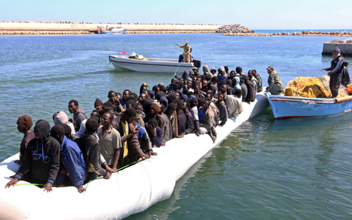 Illegal migrants from Africa arrive on shore after being rescued by Libyan coast guards.