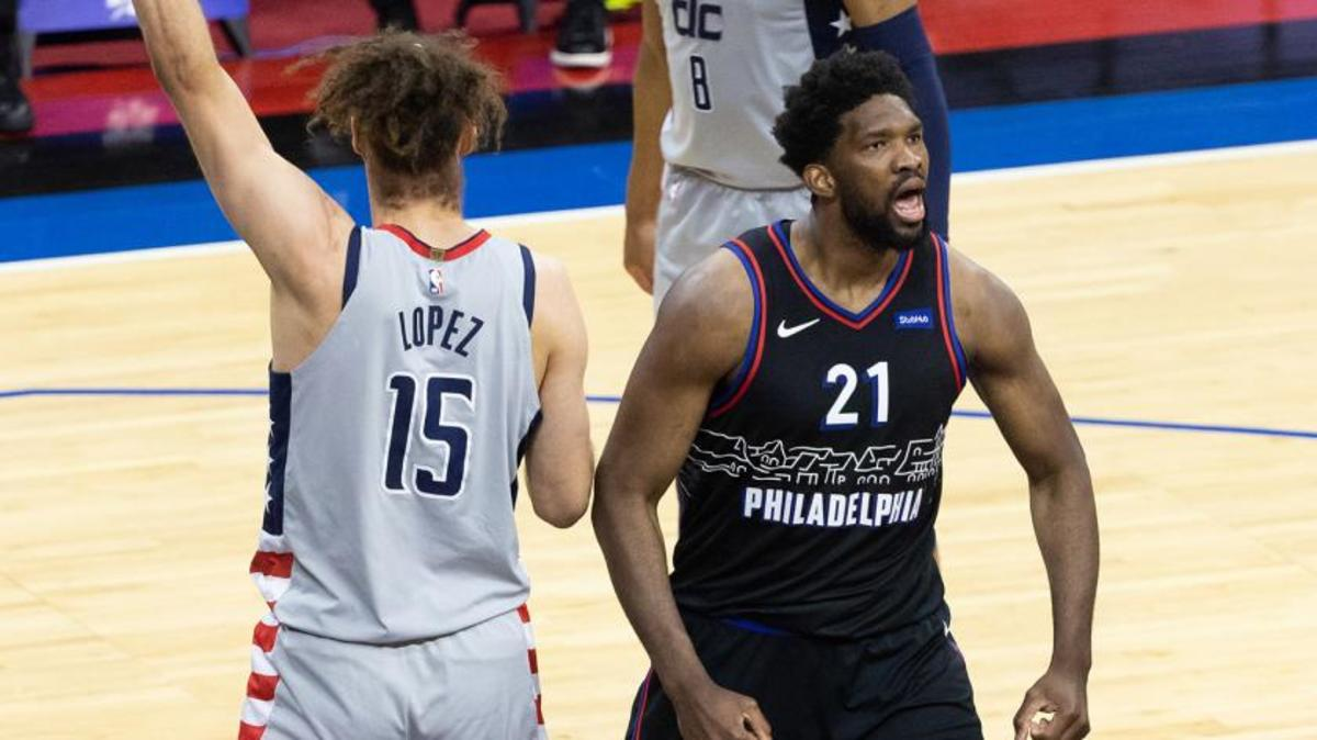 76ers center Joel Embiid and Wizards center Robin Lopez