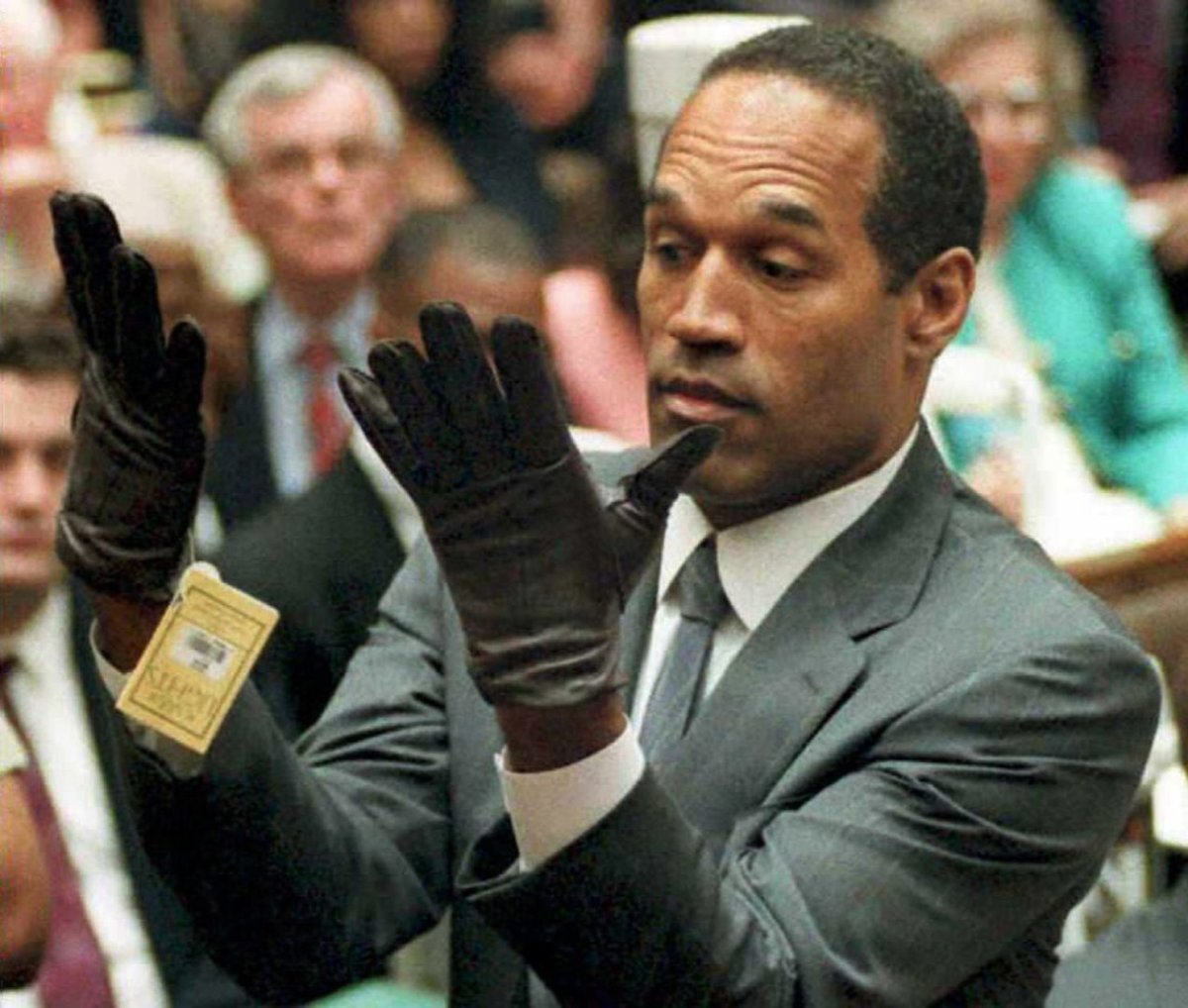 O.J. Simpson famously trying on the gloves
