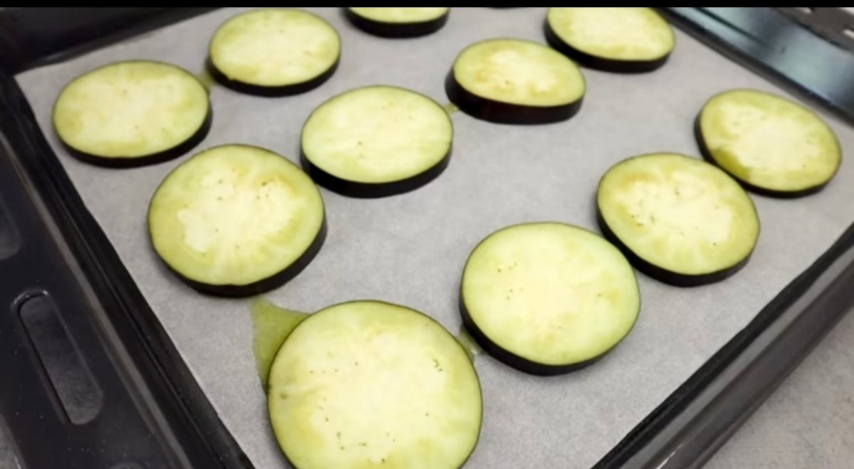 Step 4: Place sliced eggplant evenly on the pan.