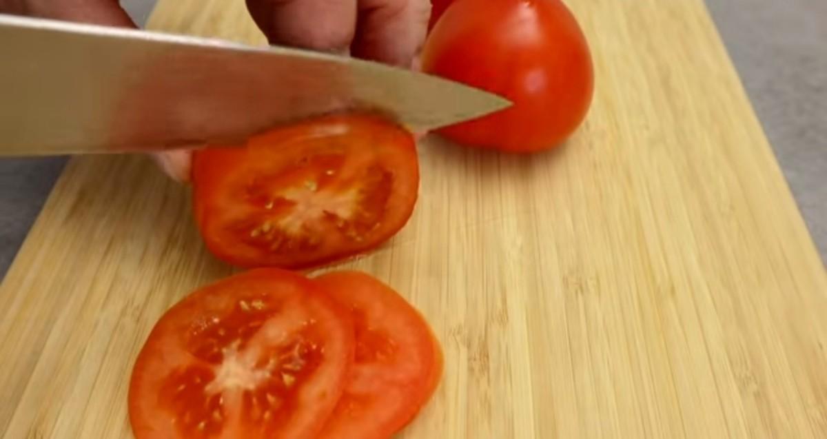 Slice the tomatoes.