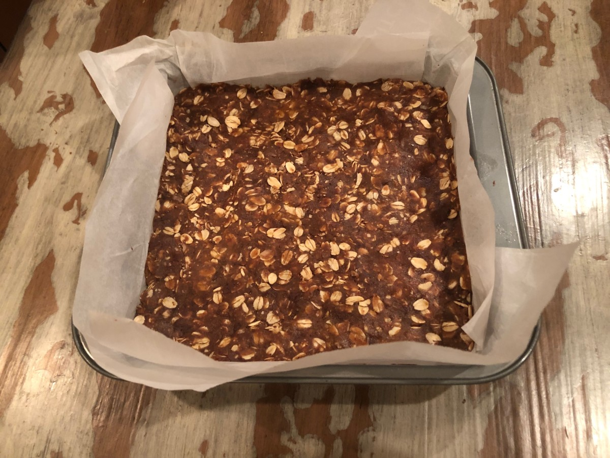 Lining the pan with parchment enables you to lift the chilled bars out in one easy motion. Then set them on the counter for cutting into individual bars.