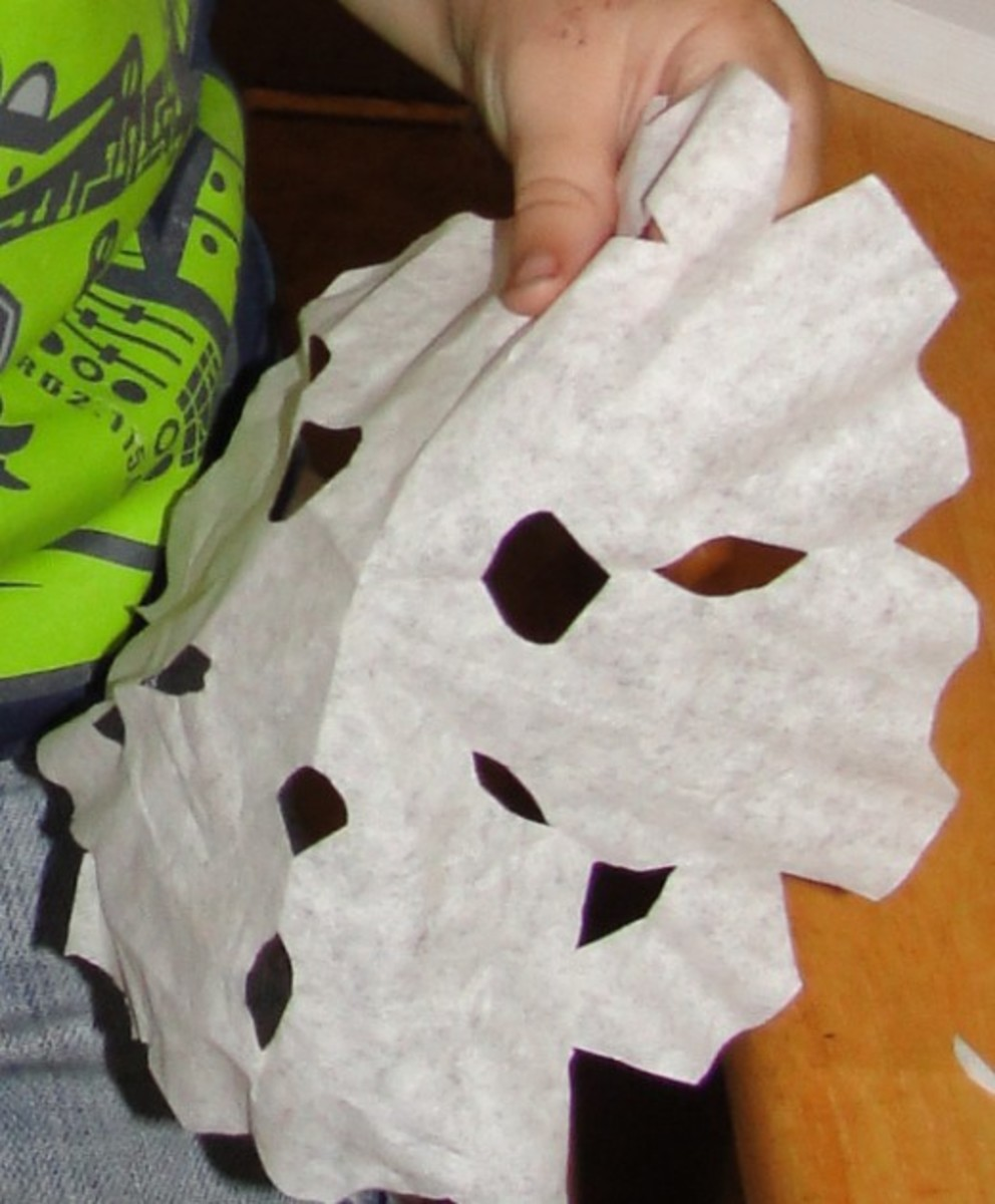 Cutting out paper snowflakes was one of the activities we did this week at home during our History Morning Basket & Activities time from the above link on the Exploration of Canada.