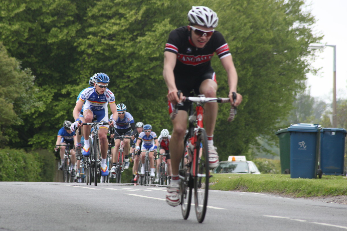 Increase your cycling speed to be able to stay ahead of the bunch like this Landale rider. Consider road racing to help you become a faster cyclist