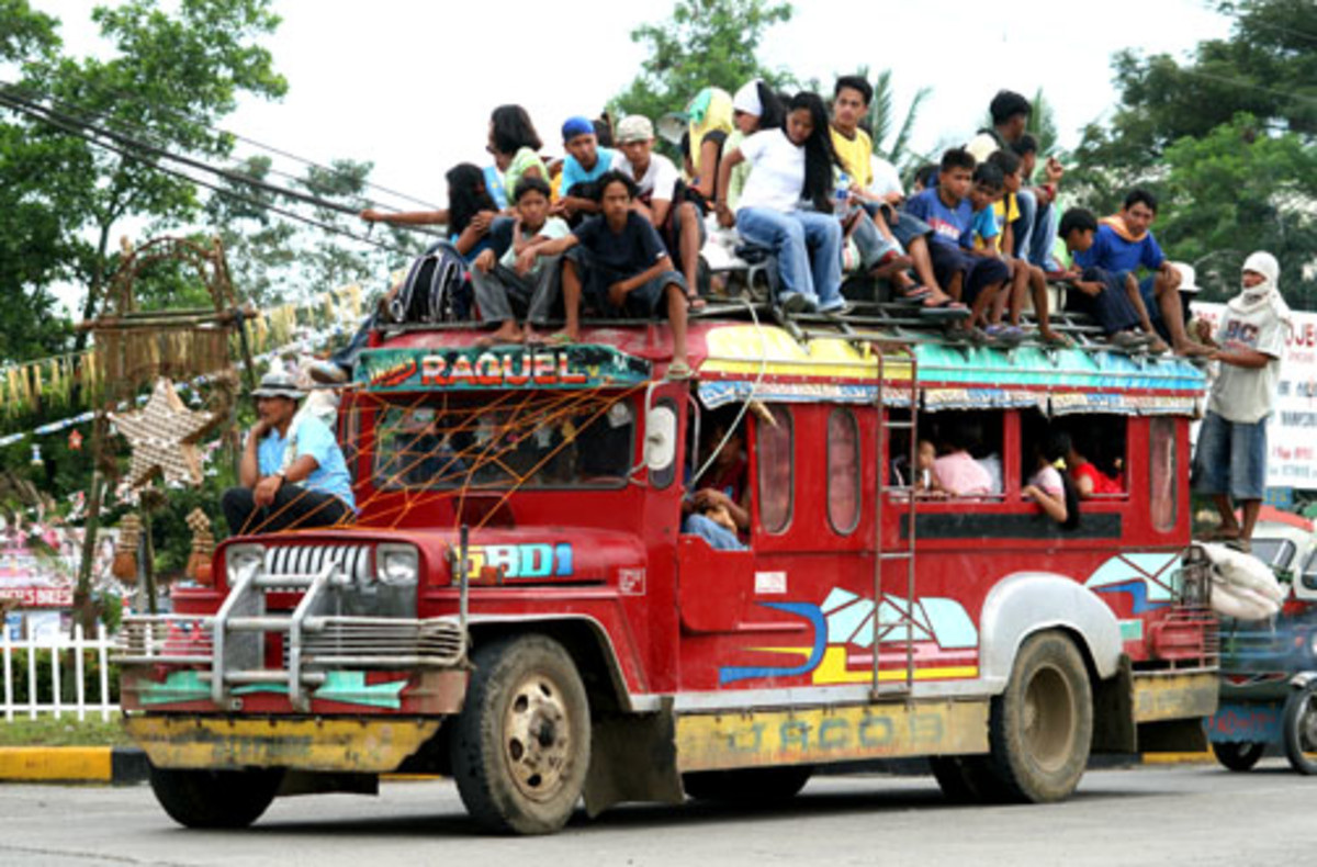 Jeepneys are a common means of travel in the Philippines. This is a typical load.