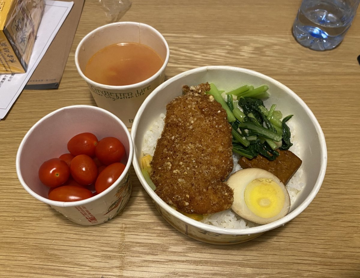 What a typical dinner looks like for us. The hotel makes the food for us and delivers it in takeout bento boxes.