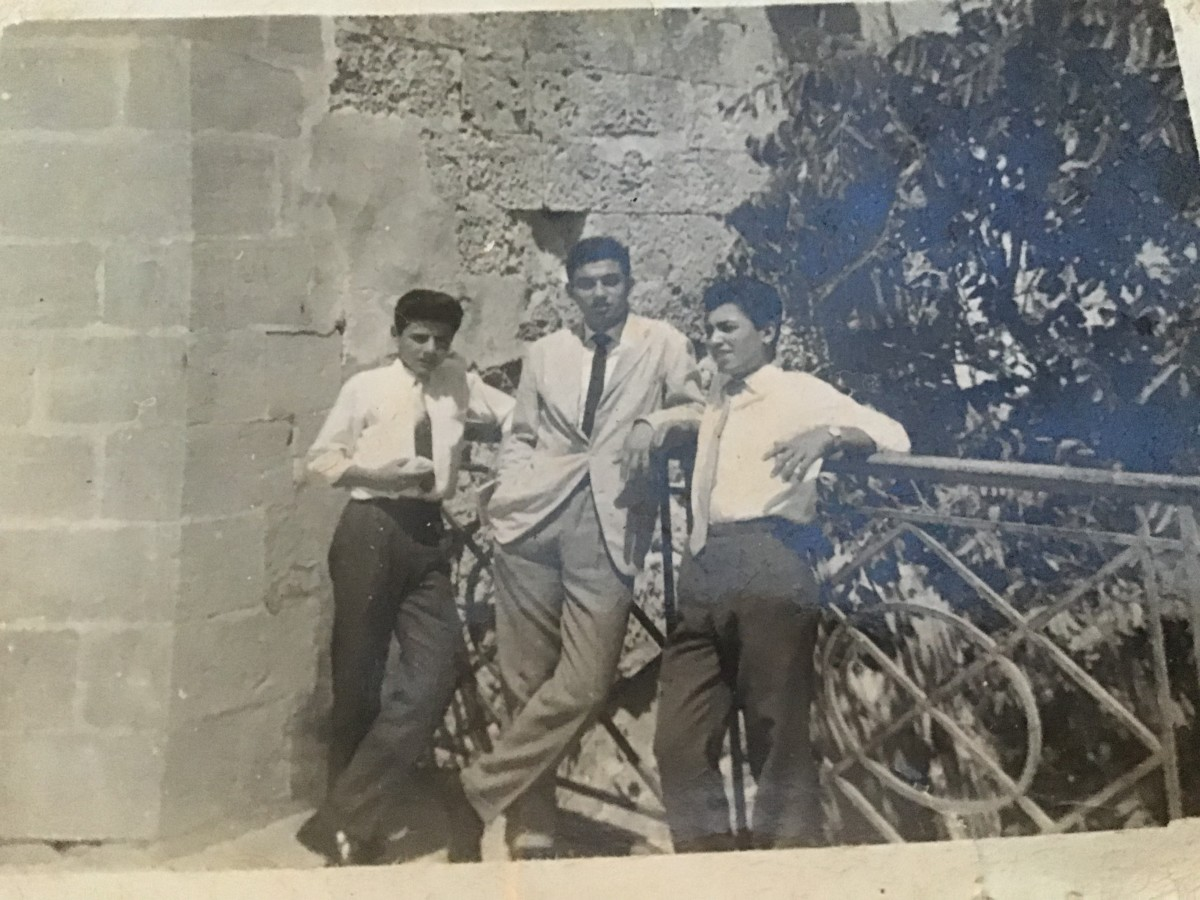 With my school friends at Upper Barakka, Valletta. Photo taken in 1961. Myself in the middle wearing a light summer jacket that was given to me by a rich friend .....
