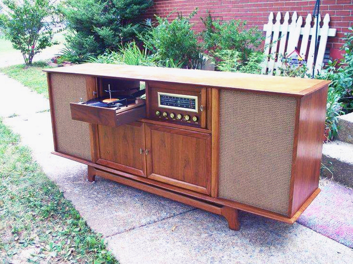 This model has a hi-fidelity AM-FM Radio and turntable It has ample storage behind the two doors and all the knobs, tuners, turntable etc. are tucked away into a drawer, keeping the design clean and streamline.