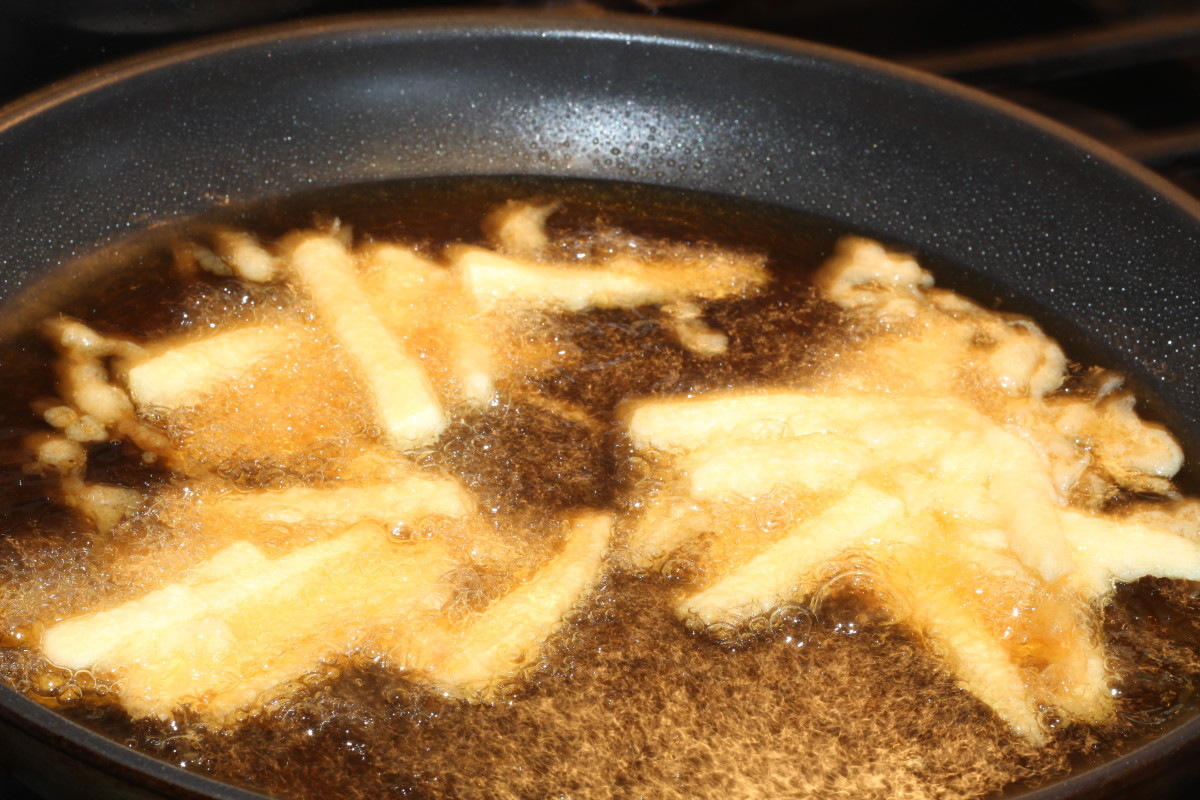 Spoon mixture into hot oil and fry on each side until brown.