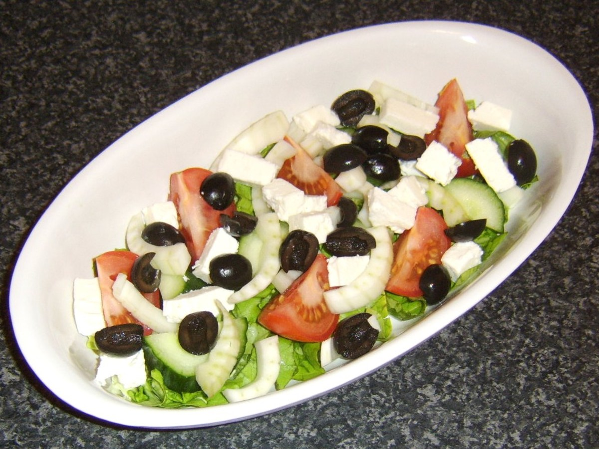 Feta cheese and black olives are added to the salad