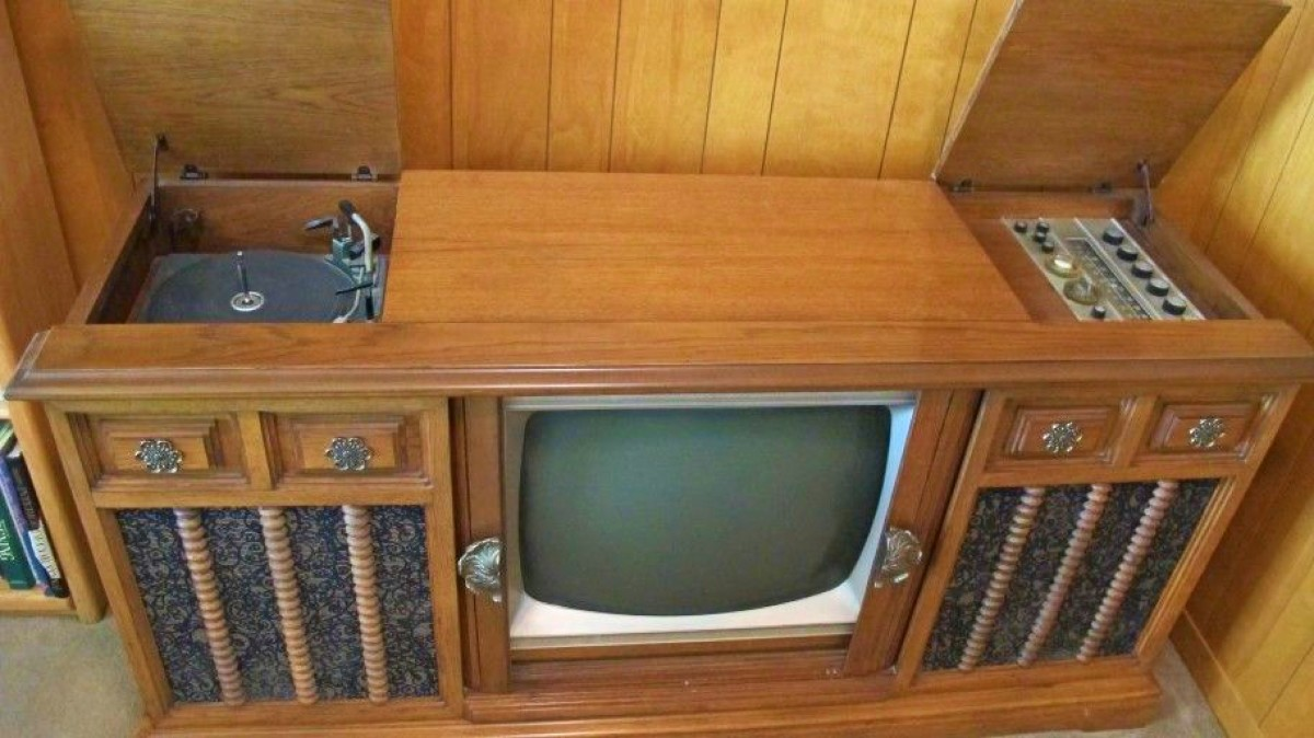 1963 Curtis Mathes Console Television, Three in One.  I believe this model is from 1963 to 1966. It looks like the green eye tuner they had with the brushed aluminum face used in the 63 Curtis Mathes AM FM chassis.