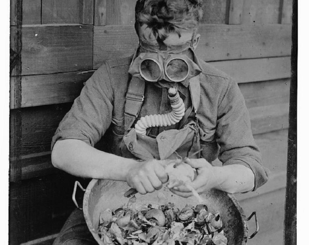 "A soldier peeling onions at Camp Kearny wears an ""anti-onion"" gas mask. 1917"