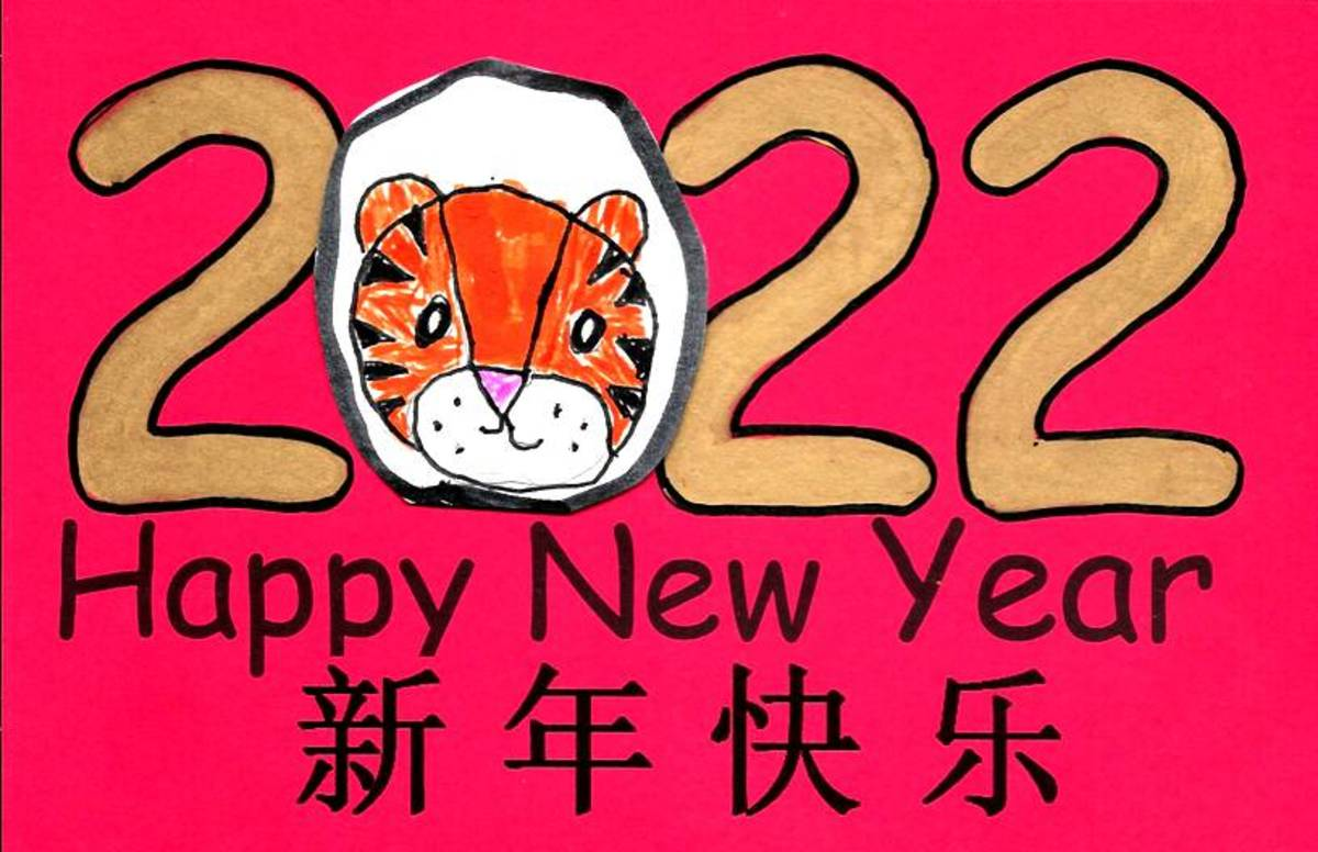 This card was printed on red paper. The child drew the tiger on white paper, then cut it out and pasted it to the card. The numbers were colored in with a gold metallic Sharpie.