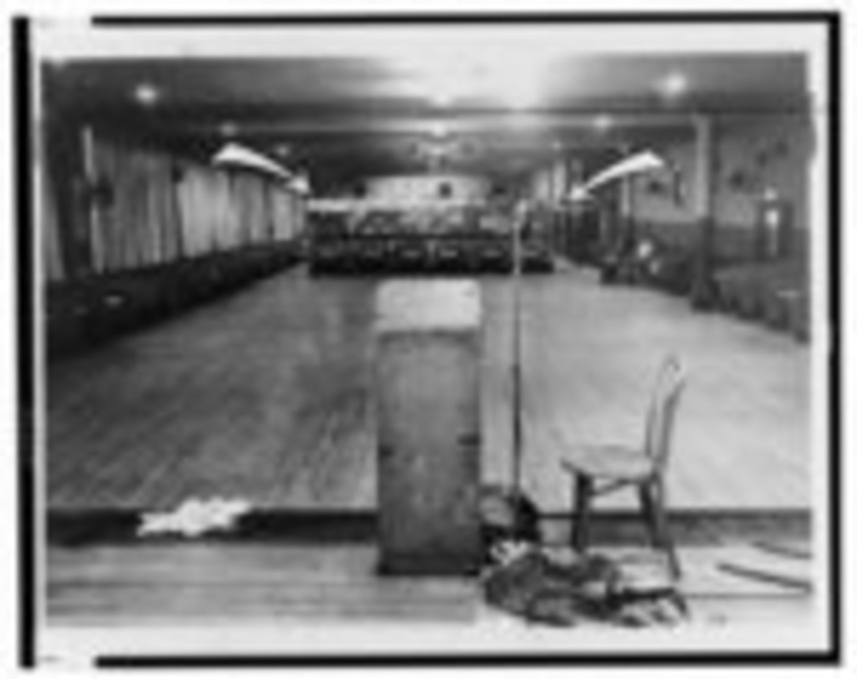This is where Malcolm X was standing when assassins struck--Note bullet holes in rostrum / World Telegram & Sun photo by Stanley Wolfson.