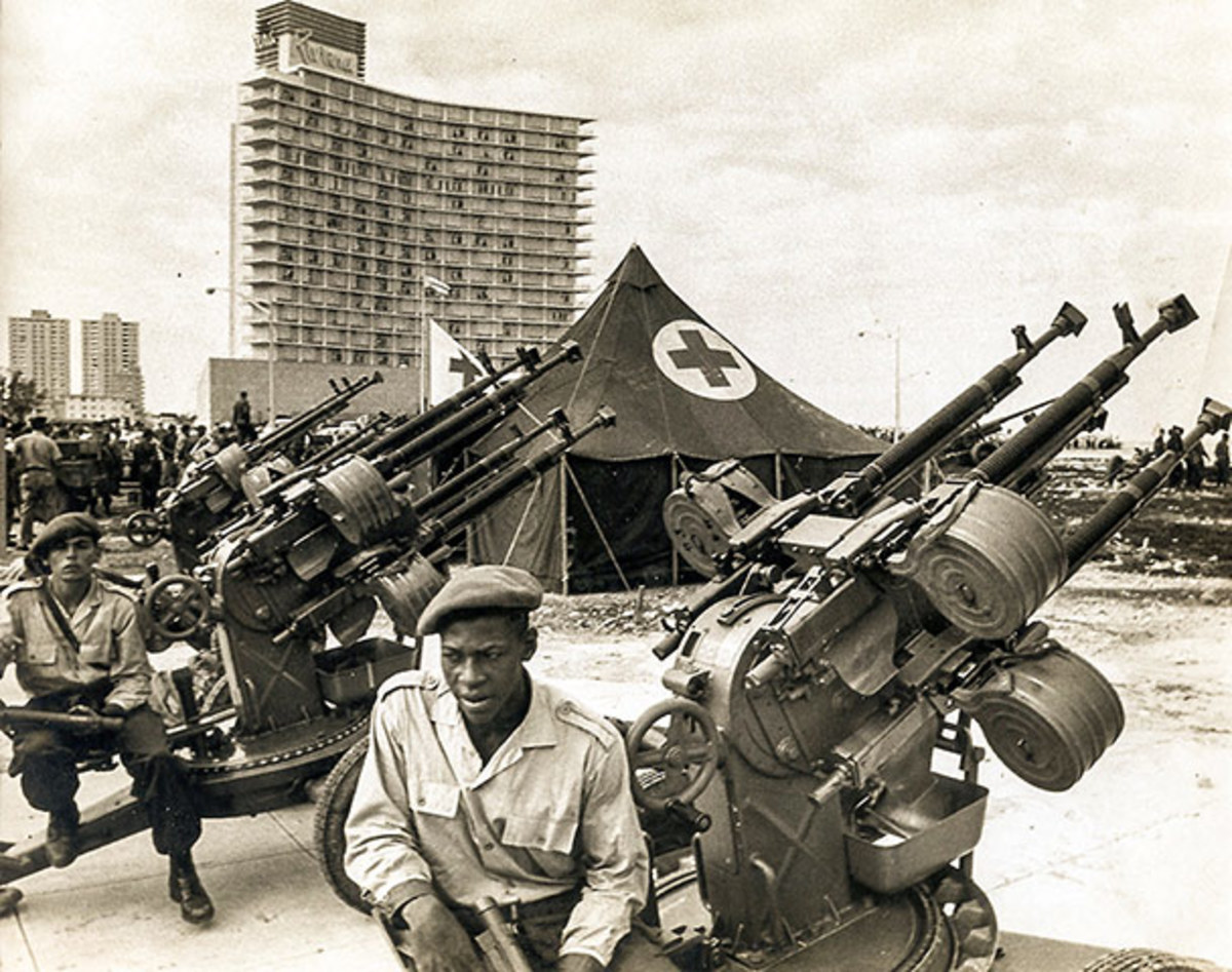 A handout picture released by Cuban newspaper Granma, showing Cuban militiamen manning an anti-aircraft battery of Czechoslovakian-made M53 12.7mm quad guns at Havana's Malecón during the 1962 missile crisis