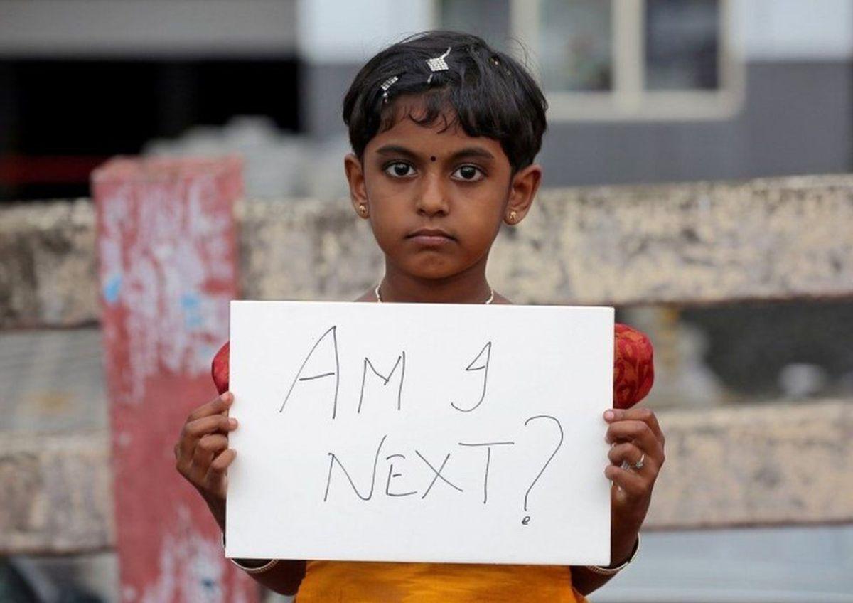 Girl in India protesting against child rape.