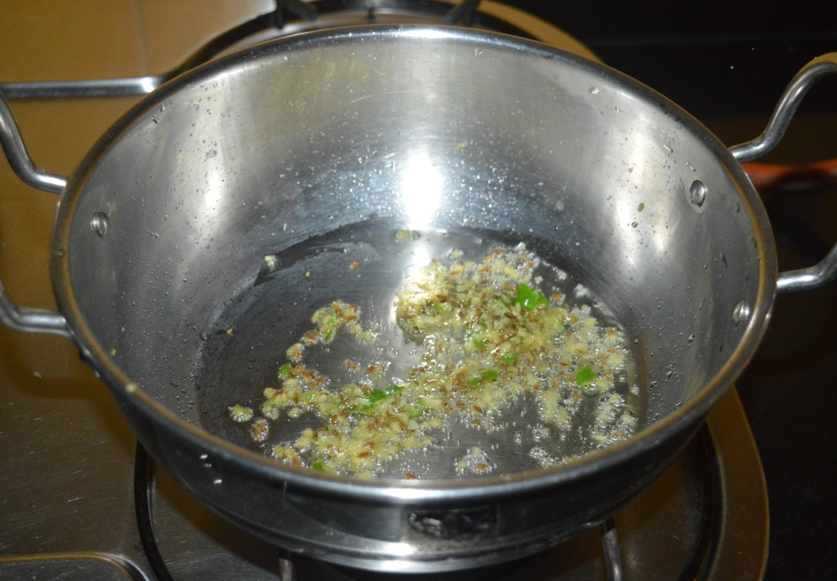 Step four: Heat oil in a deep-bottomed pan for making the stuffing. Add the paste. Saute on medium-low heat for a few seconds. Increase the heat.