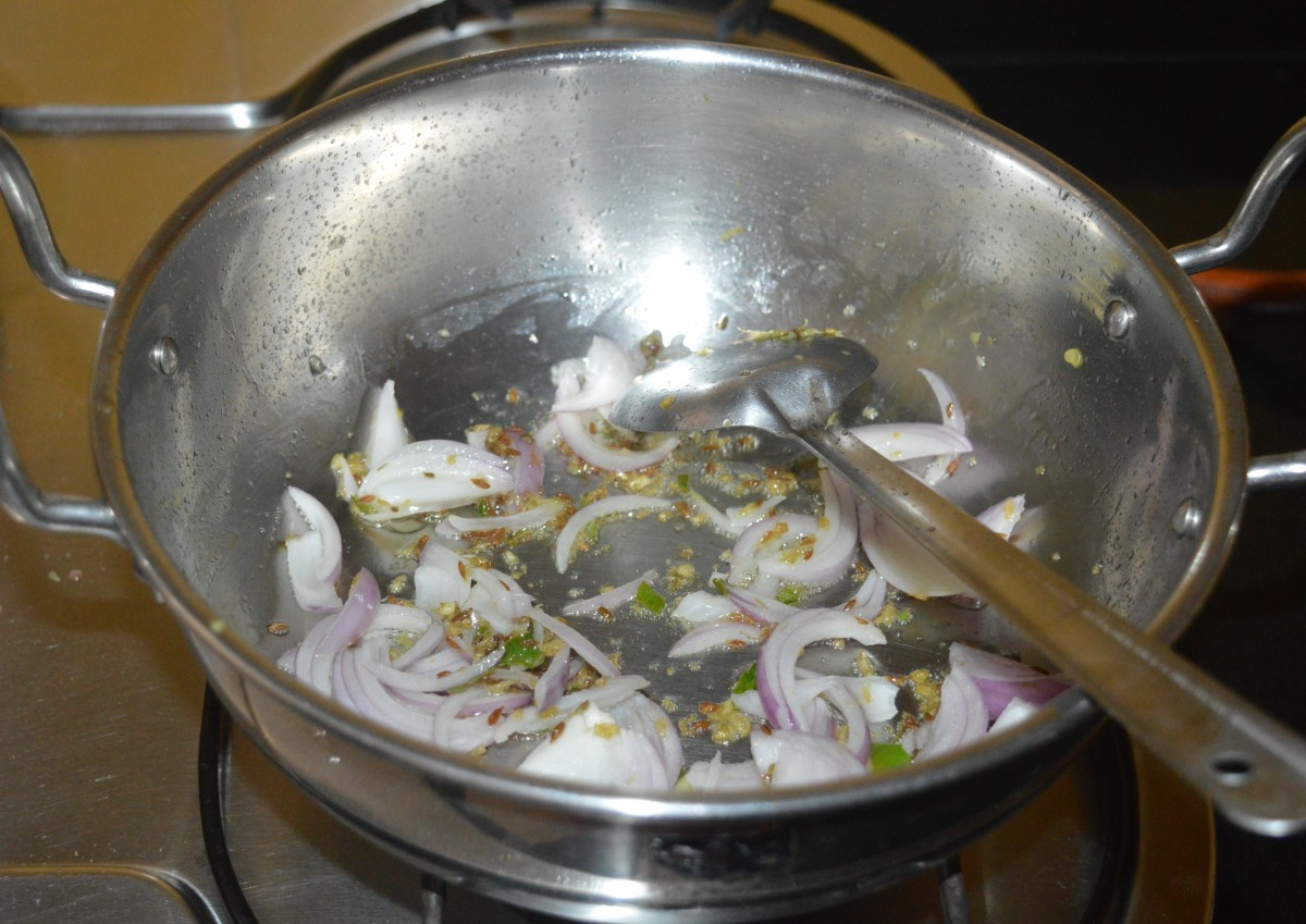 Throw in chopped onions. Continue to saute for a minute.