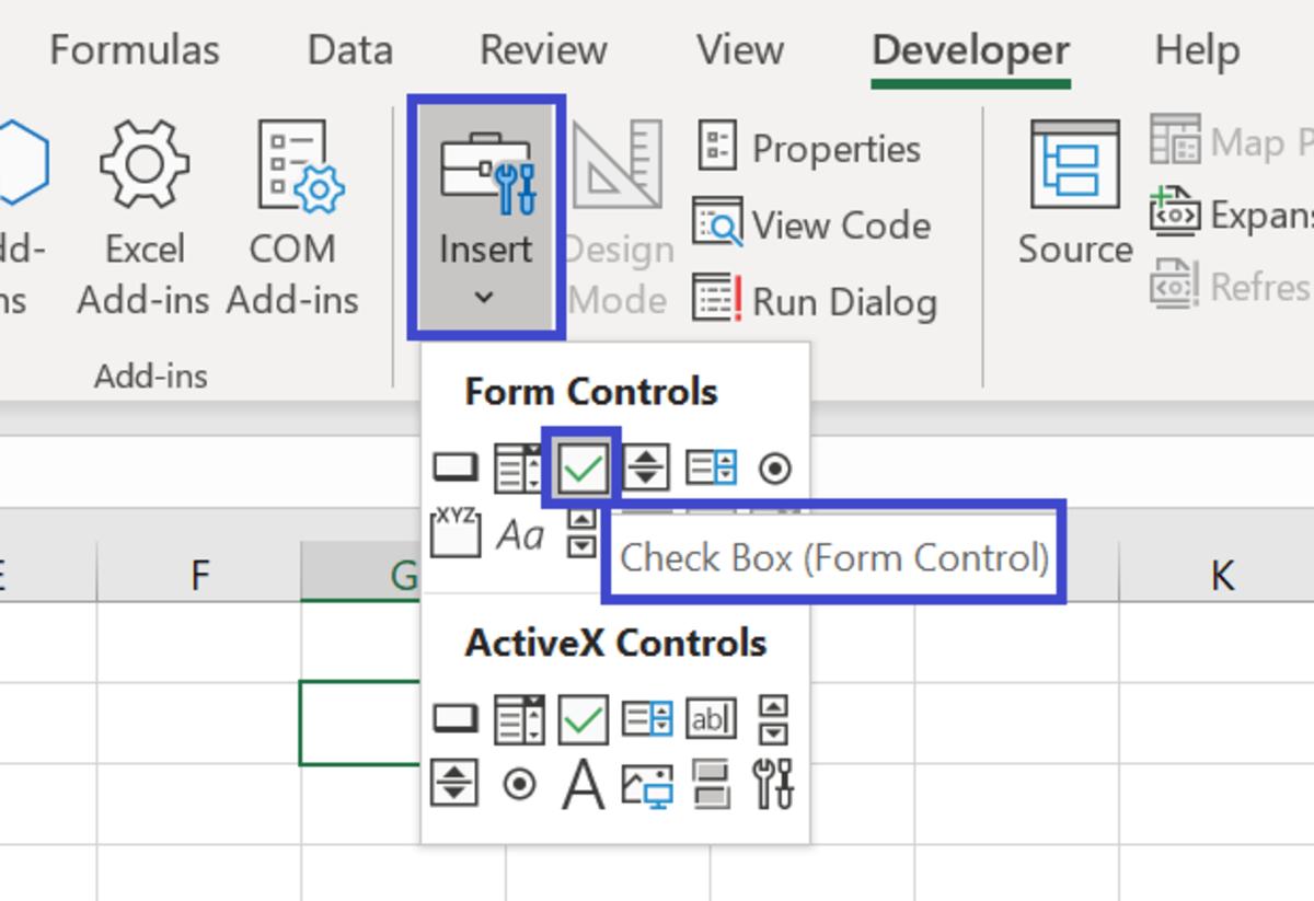 Insert > Checkbox (Form Control)