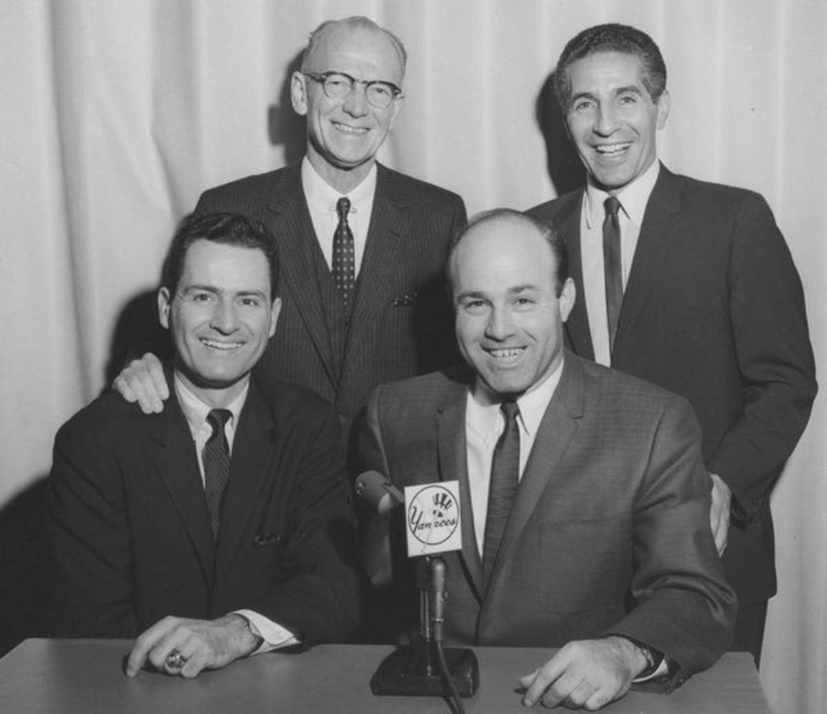 In the booth:  Front Row L-R: Jerry Coleman and Joe Garagiola. Back row L-R: Red Barber and Phil Rizzuto.