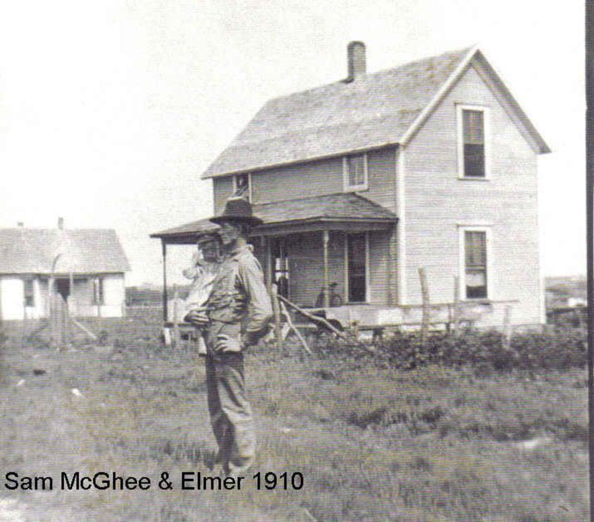 Bertha's father and brother, Sam and Elmer McGhee with their home in the background.