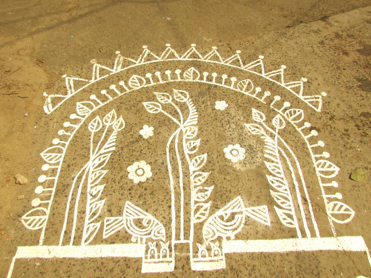 tree, flower and bird motif in Alpana