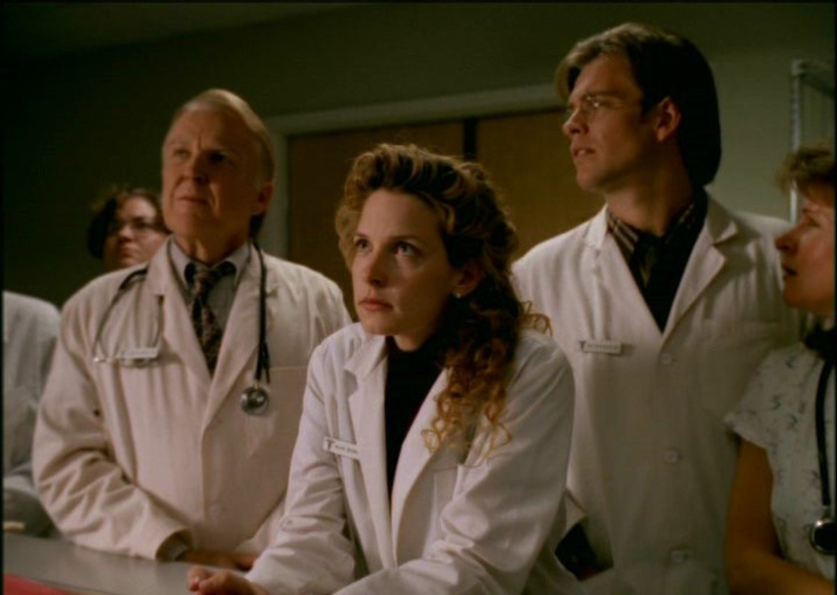 Dr. Charles Napier (Anthony Zerbe) Dr. Valerie Brennan (Jensen Daggett) and Dr. Matthew Rogers (Michael Weatherly) anxiously await the first impact in Kansas City.