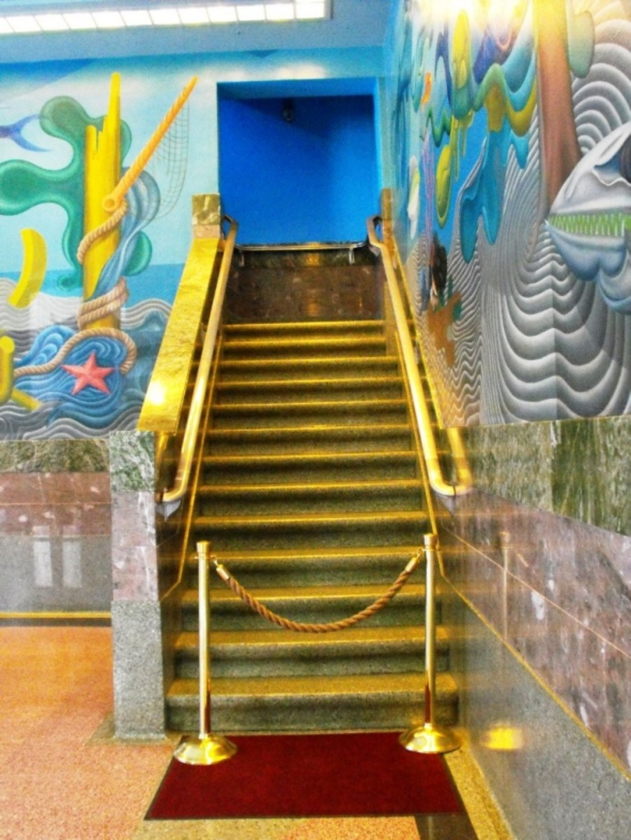 Brass staircase and murals.