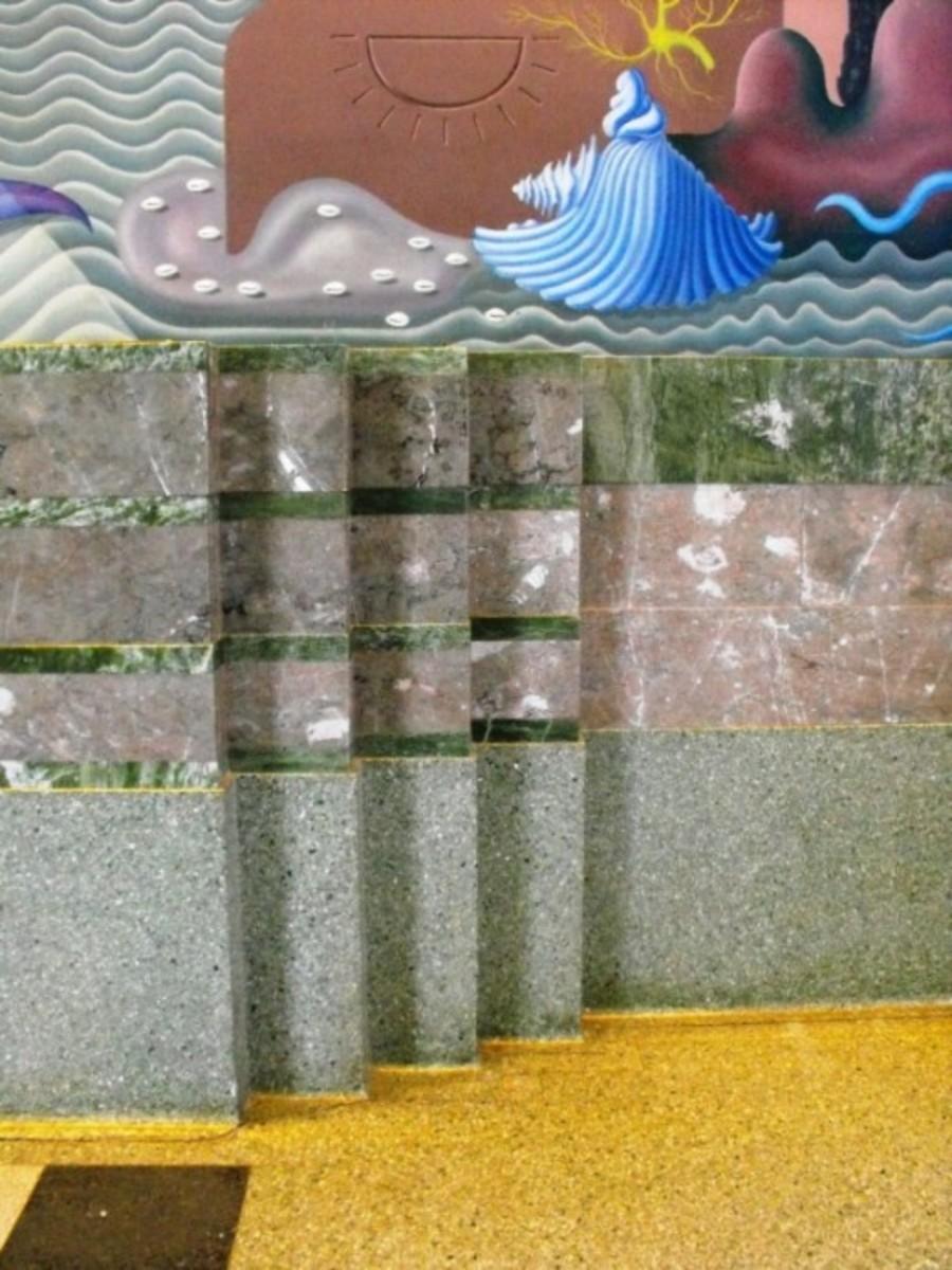 Inside lobby. Art deco stone walls to 5 feet high.