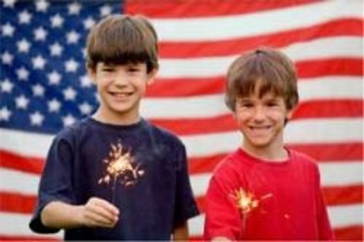 Boys in front of the American Flag
