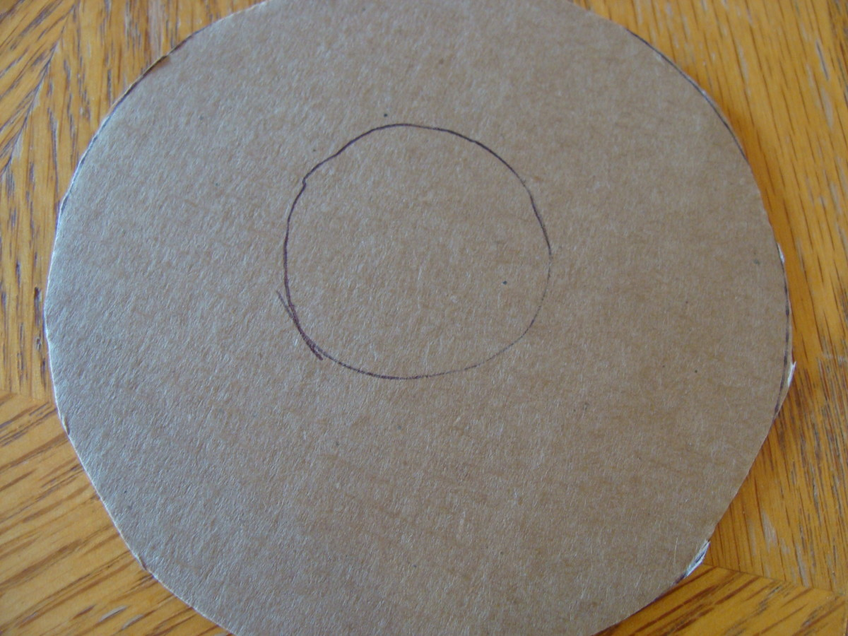 Using a cardboard circle, cut out the diameter of the wrapping paper tube.