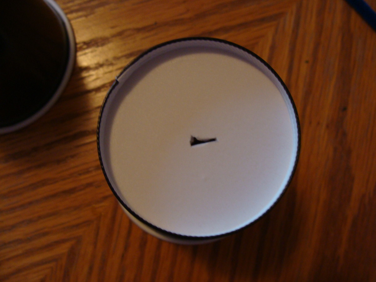 Poke a hole in the bottom of the cup.  See video for more detailed instructions!