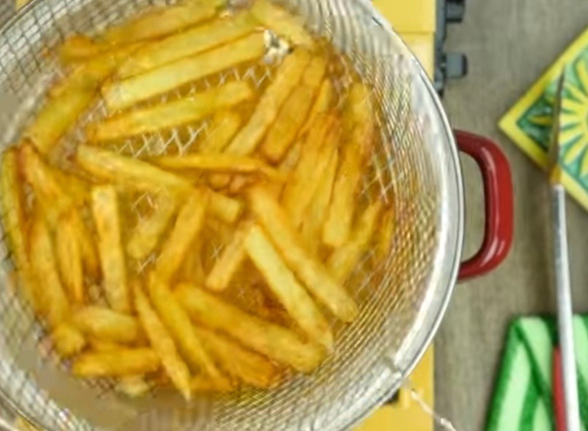 Step 5: Fry the potatoes until they turn crispy.