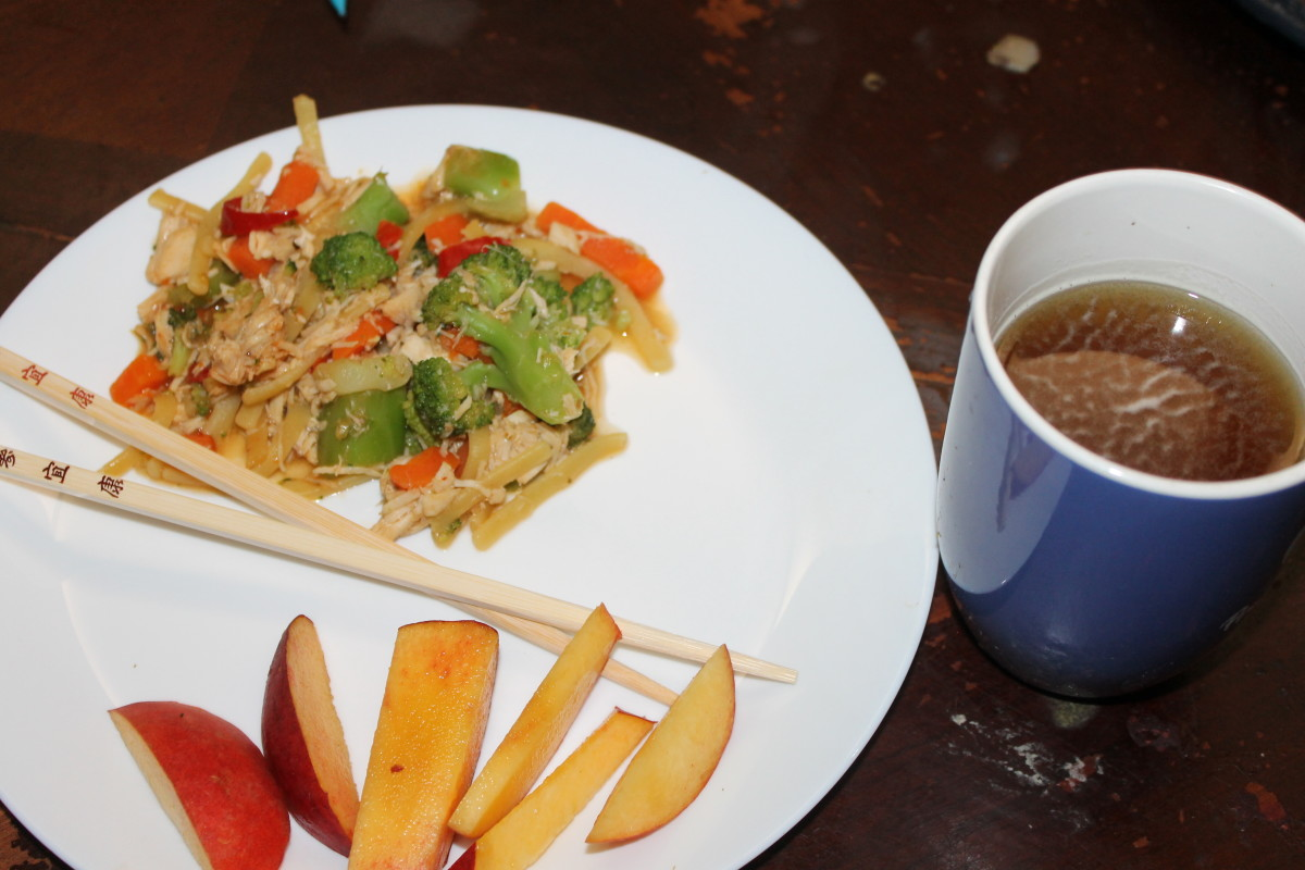 Eating a meal with chopsticks: Chicken Teriyaki (from Aldi), peaches, and Oolong tea