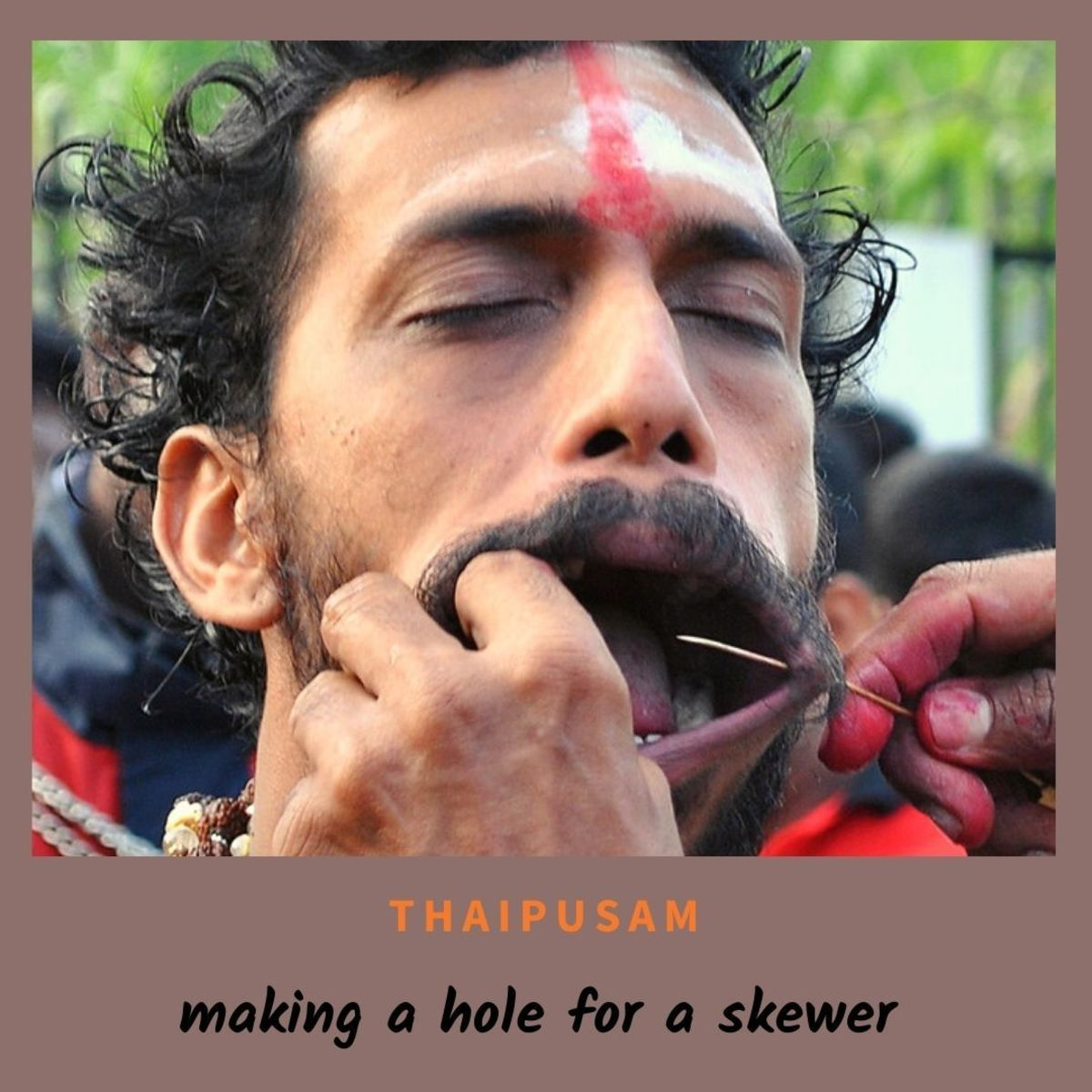 A hole was made on this devotee's cheek to allow for a spike to easily pierce through his cheeks.