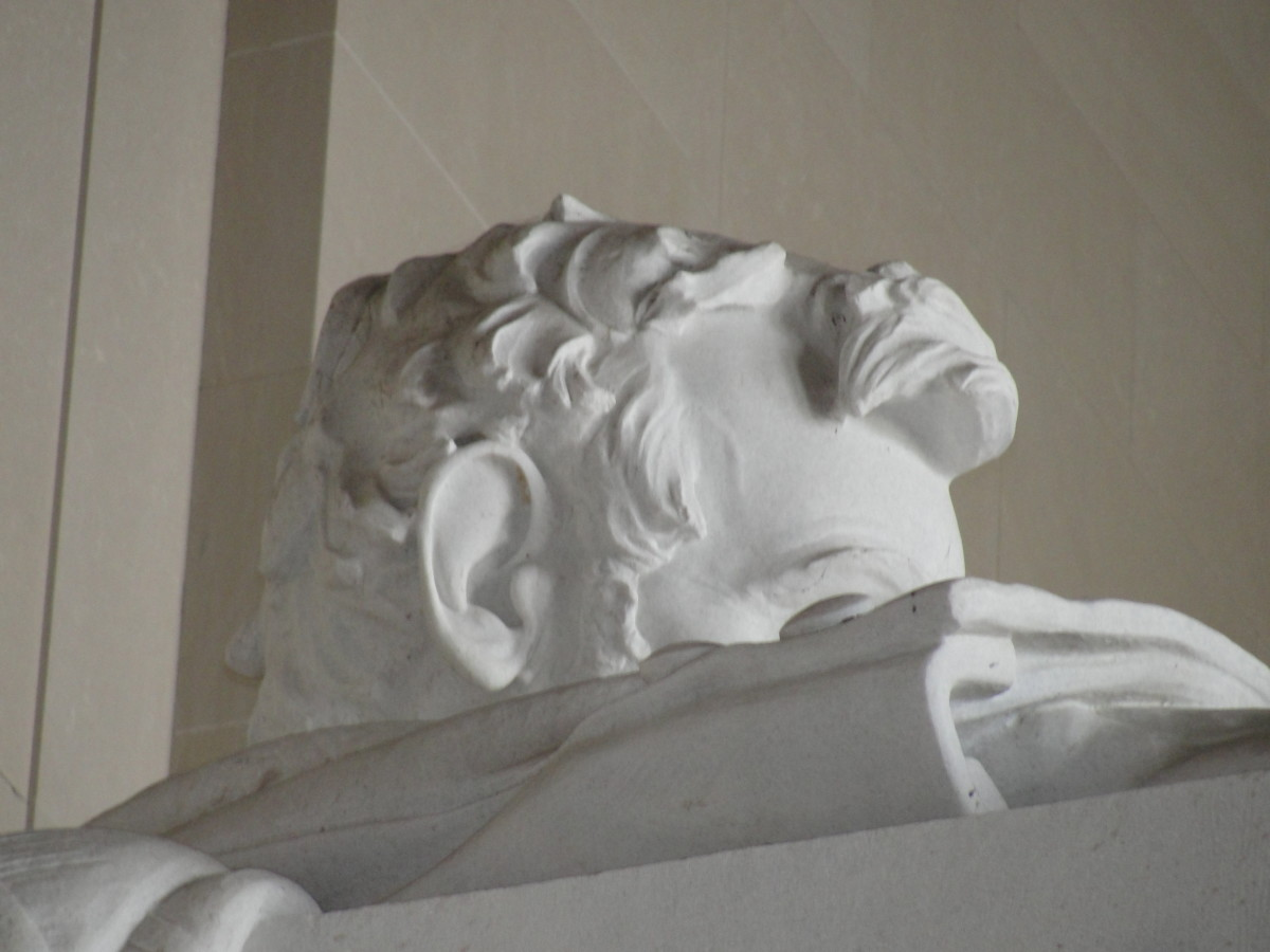 "Supposedly Robert E. Lee's face was chiseled into the back of Lincoln's head because they'd been close friends. Also notice the word ""FUTURE"" in the inaugural address on right hand side of the wall. It was mistakenly carved as ""EUTURE."""