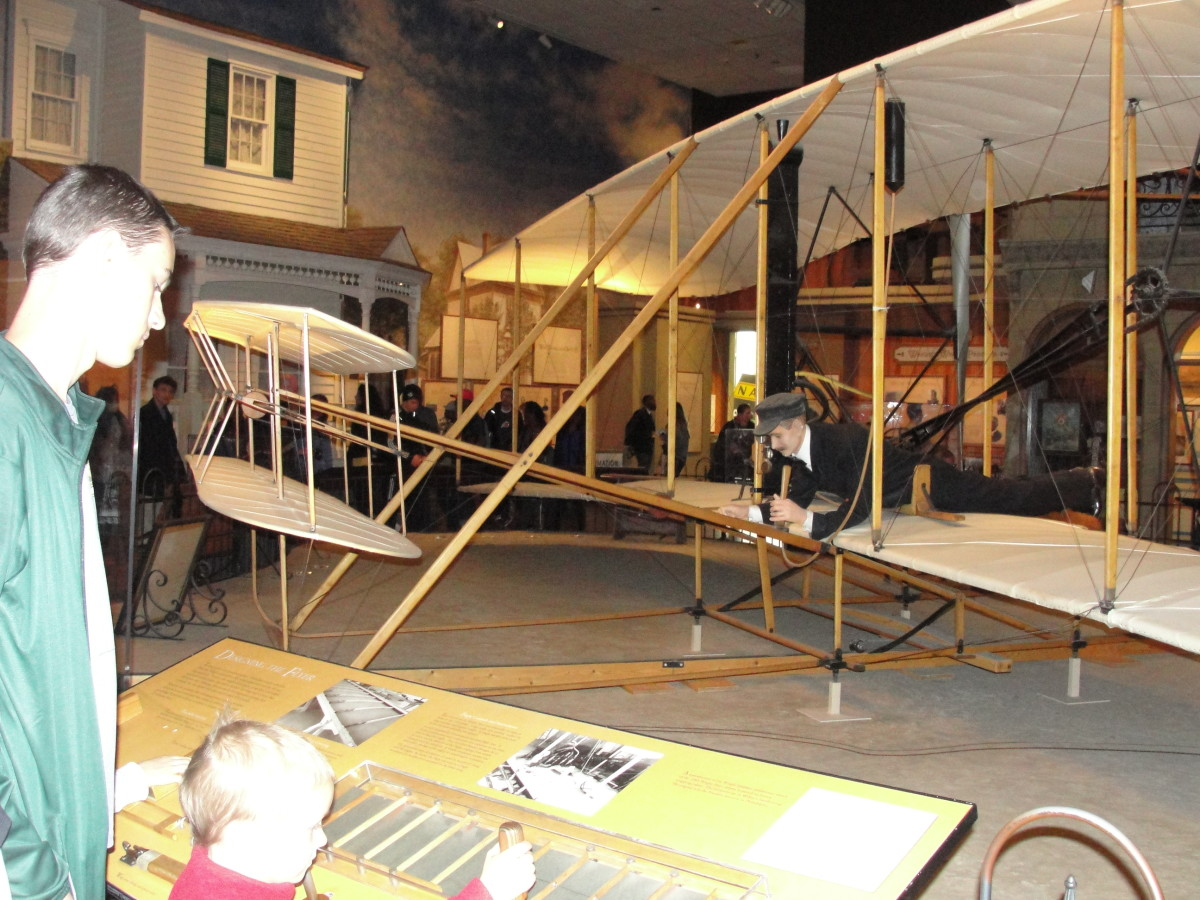 Checking out the 1903 Wright Flyer at the National Air & Space Museum - Did you know the museum almost didn't acquire this piece because of a dispute over who was the first inventor of the airplane: them or Mr. Langley, secretary of the Smithsonian?