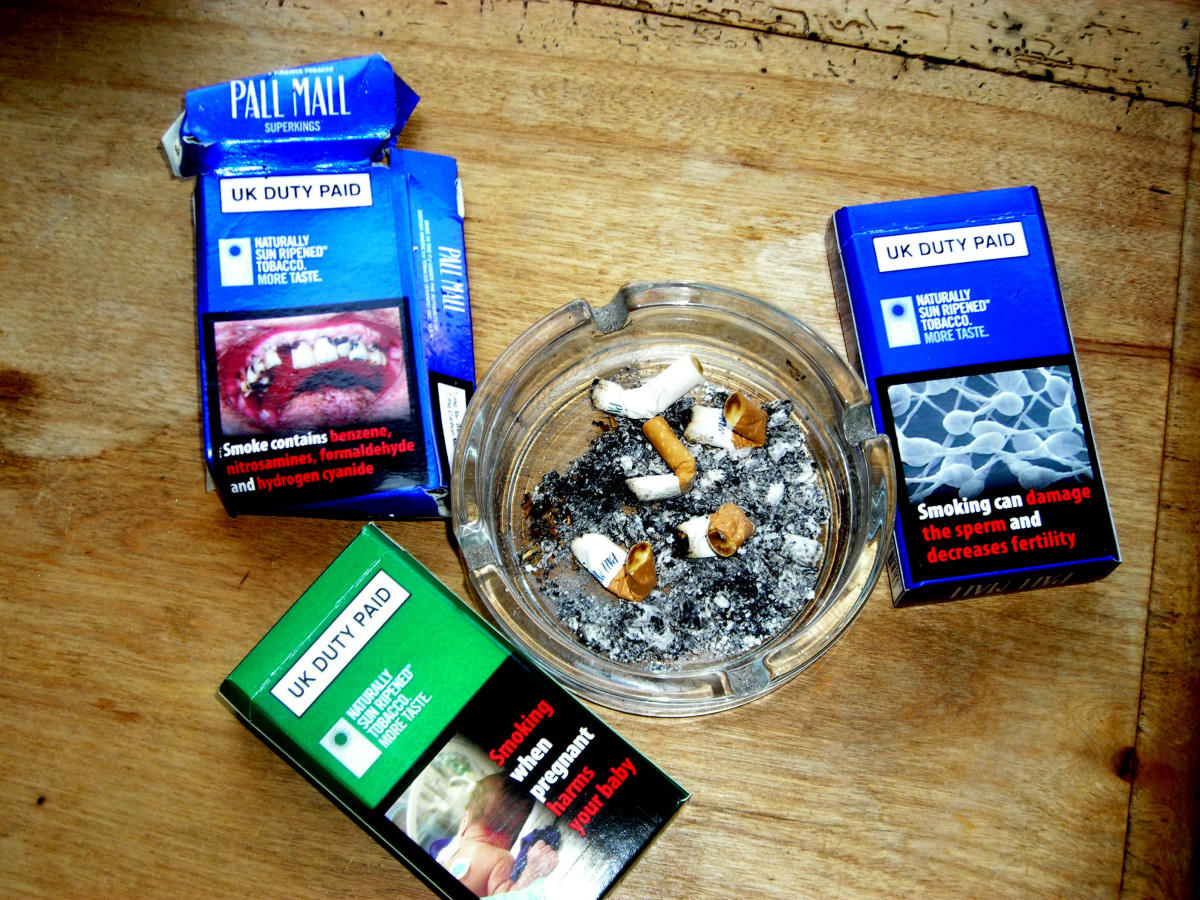 Cigarettes with health adverts on the packets