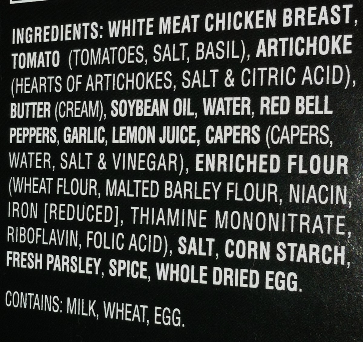 "The list of ingredients lists the main items in bold font. Any ingredients which contain ""other"" ingredients, (such as the flour and capers), have the other ingredients listed in parentheses."