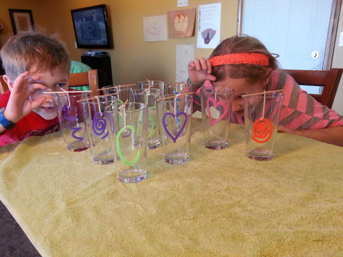 Lining up the dangling crystals in each glass before adding the solution.