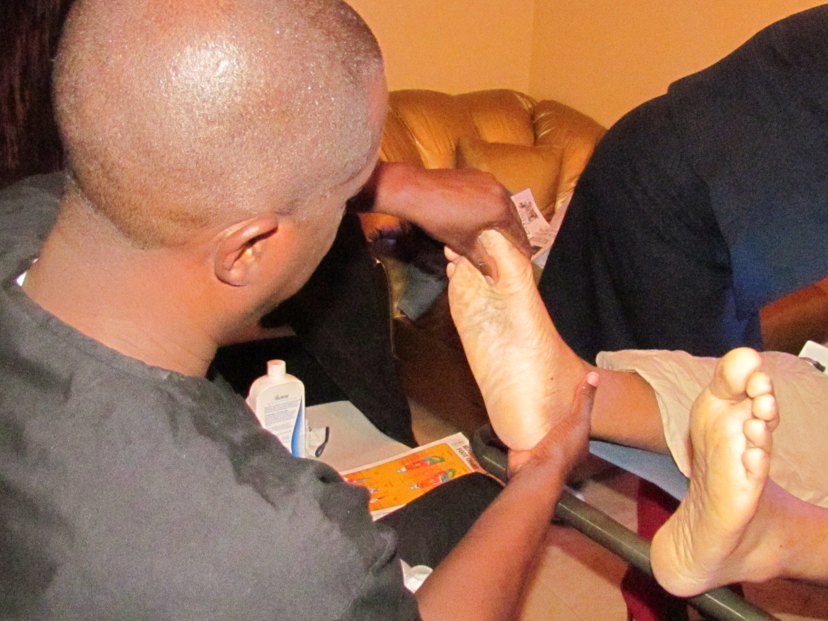 Robert Fulford III, works on the feet to stimulate possible circulation through organs within the body.
