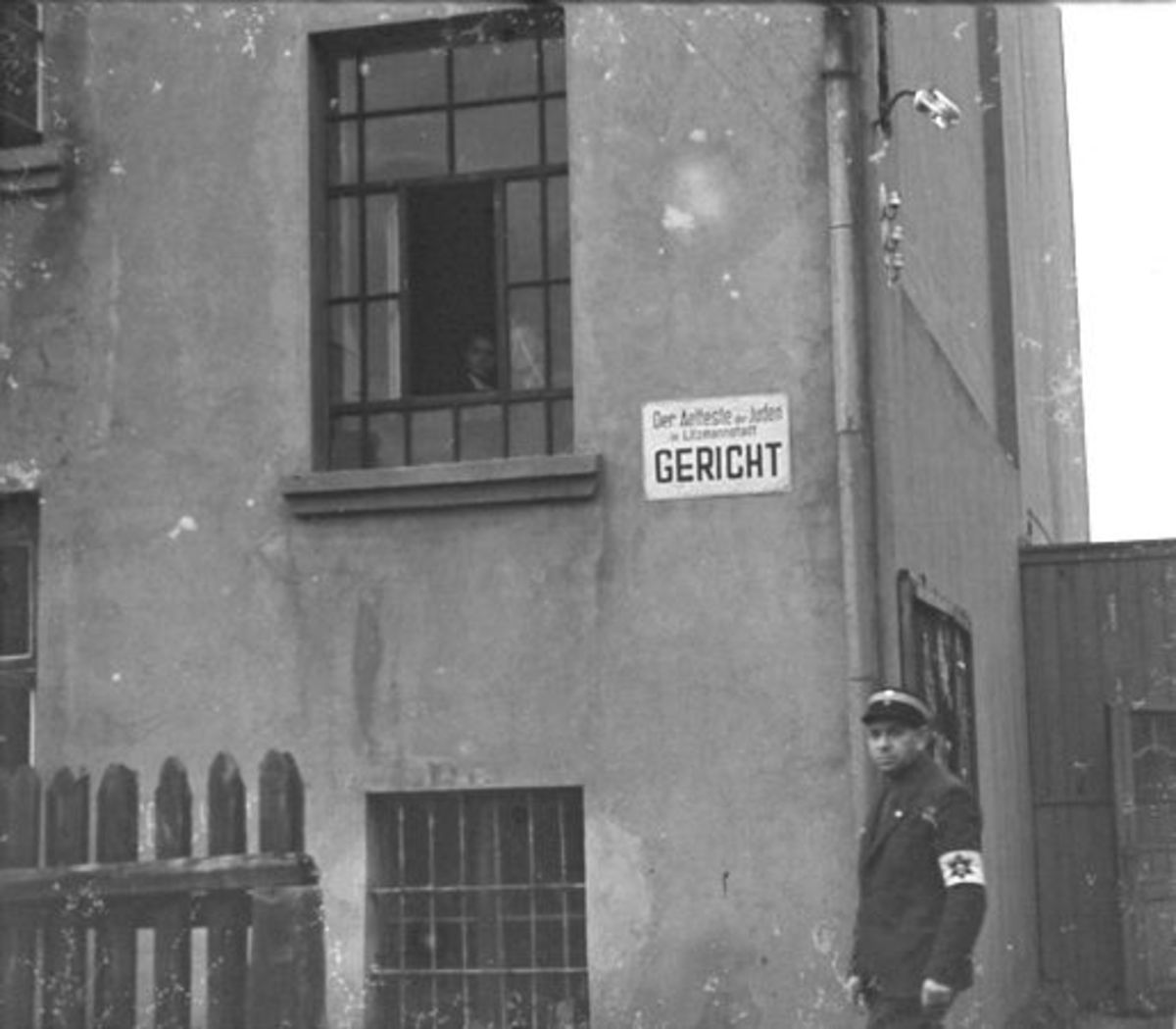 A Jewish policeman outside the courthouse in the Warsaw Ghetto.