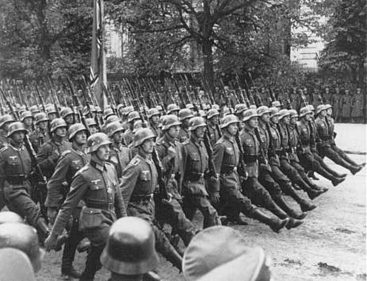 German troops parade through Warsaw after the surrender of Warsaw, Poland, September 28-30, 1939.   United States Holocaust Memorial Museum.