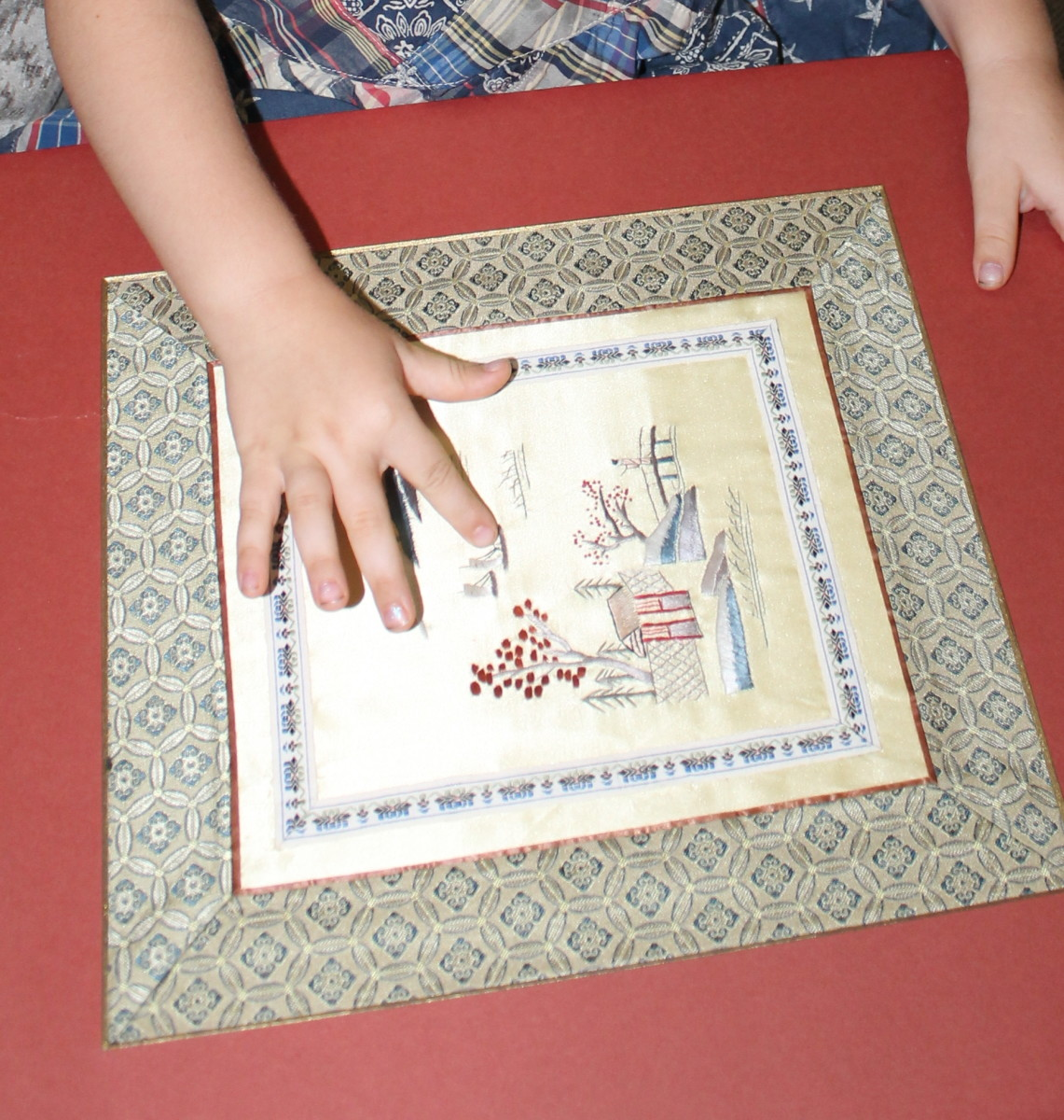 Examining Chinese embroidered silk