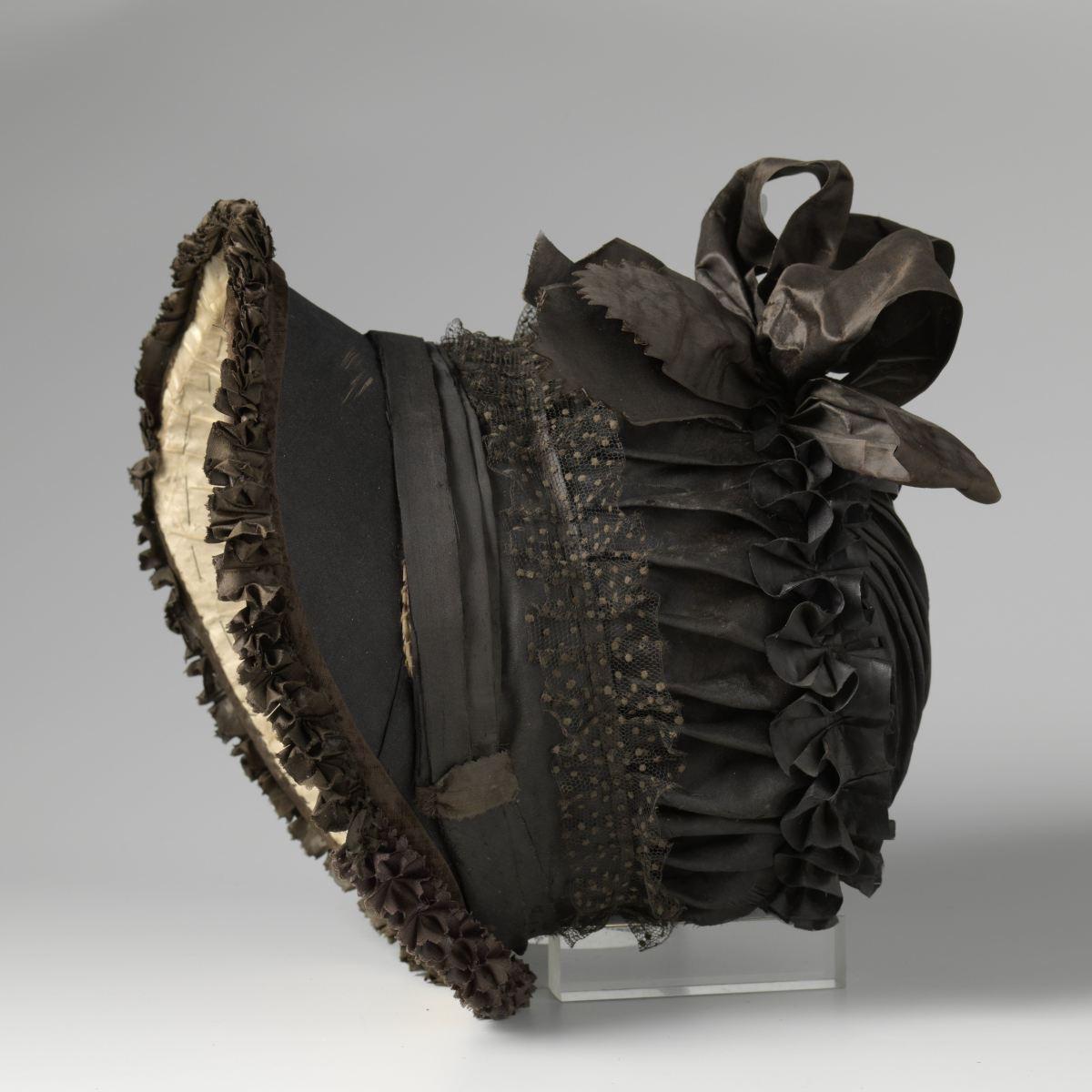 Poke bonnet - black silk with box pleated black silk band, ribbon, and black polka-dot tulle circa 1850 - 1820