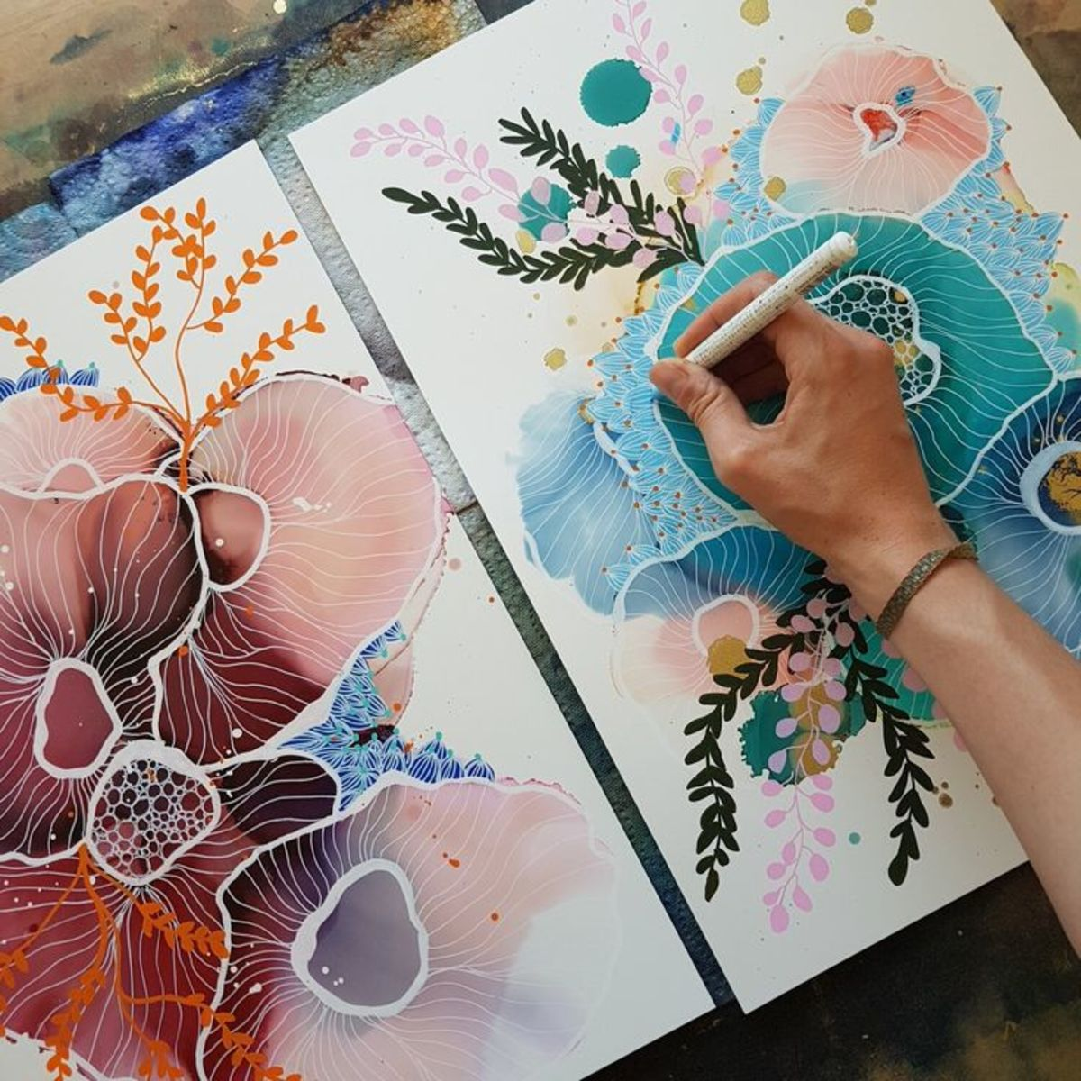 You can use alcohol inks on art journals and scrapbook pages. Learn how to draw on alcohol inks.