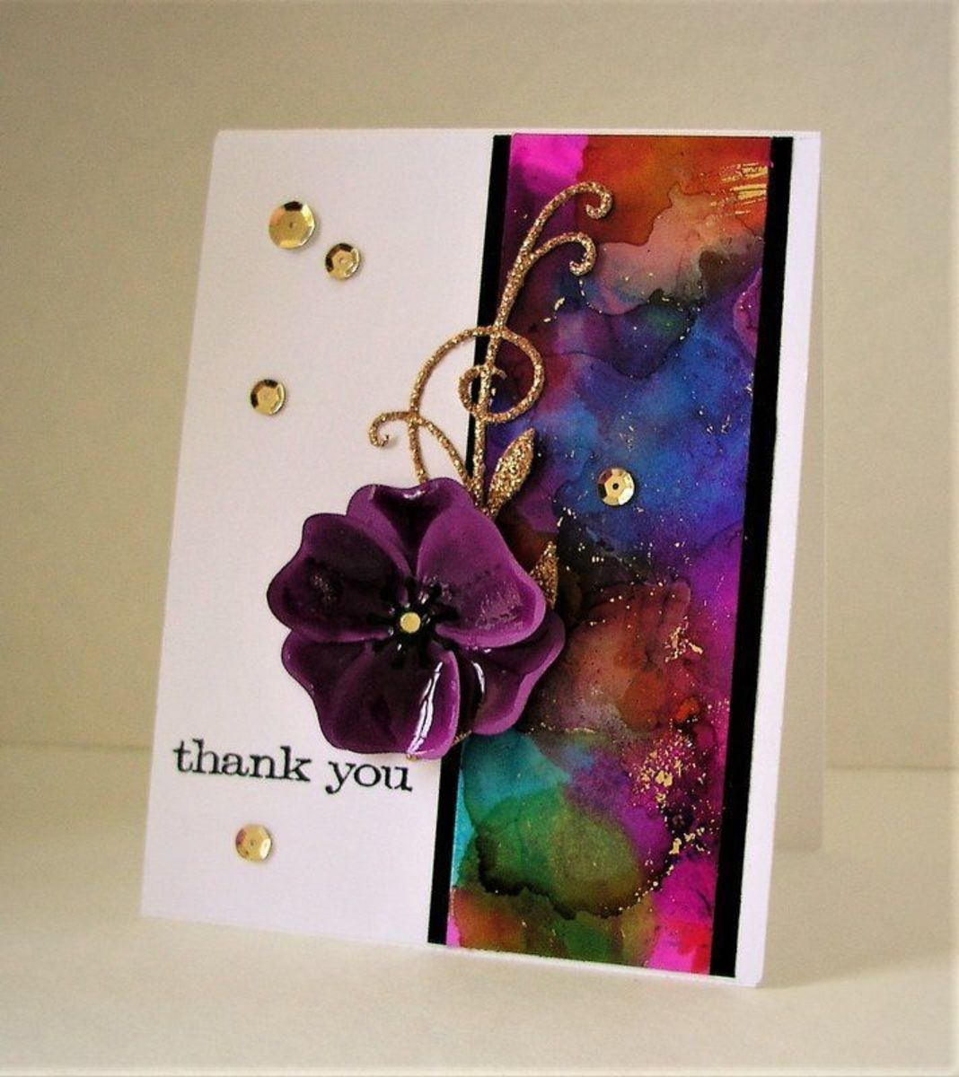 Alcohol inks can be used on glossy paper to make greeting cards